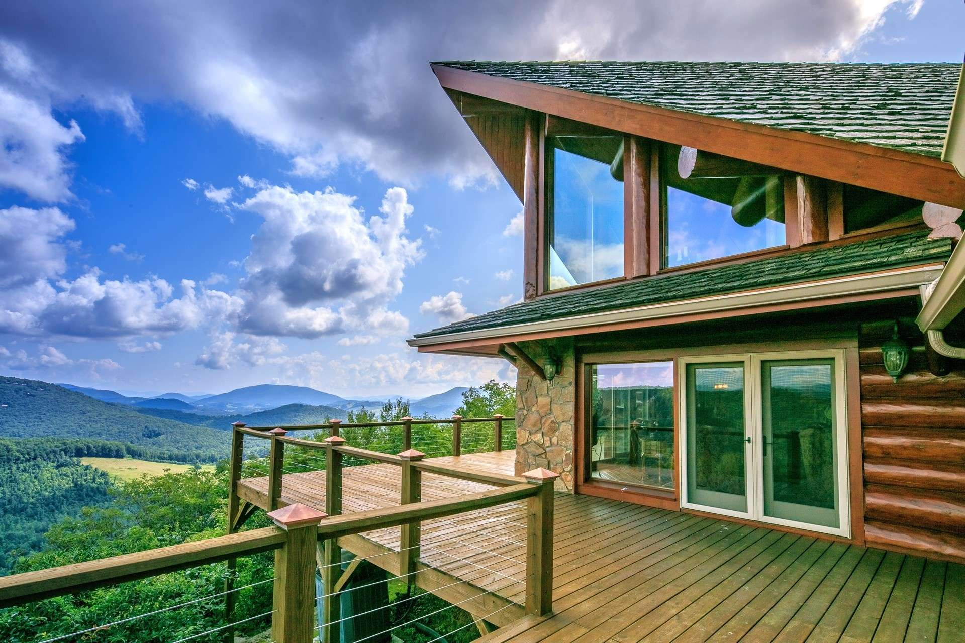 This mountaintop oasis offers end-of-the road privacy, a stunning log home, guest house (both furnished,) and 19 beautifully wooded acres offering additional home sites, if desired.