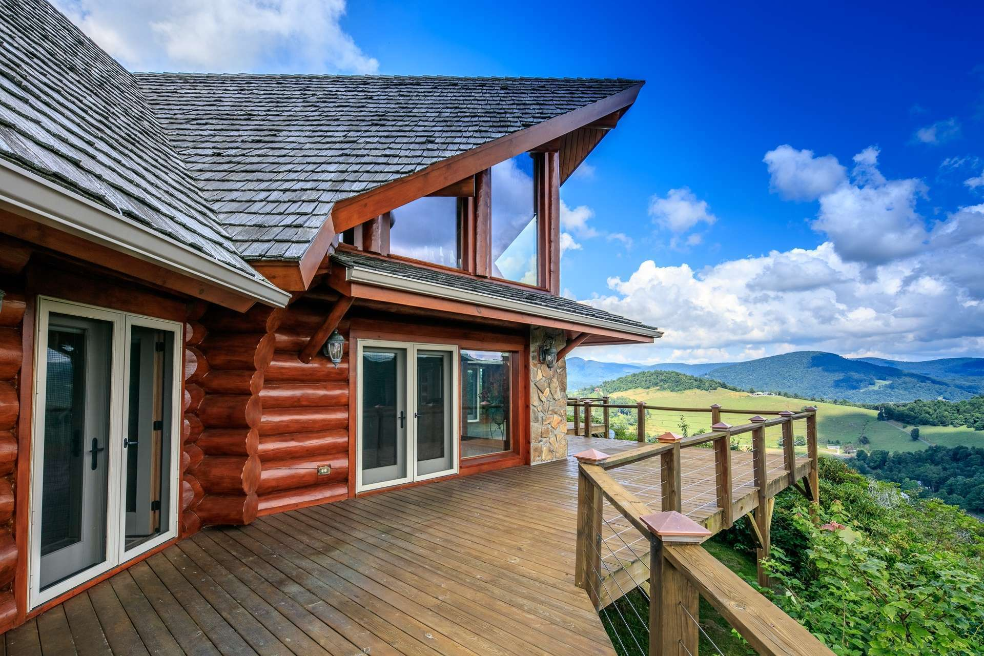 Expansive decking provides plenty of space for outdoor entertaining. Or, simply relax with your favorite beverage while enjoying the views and gentle mountain breezes.