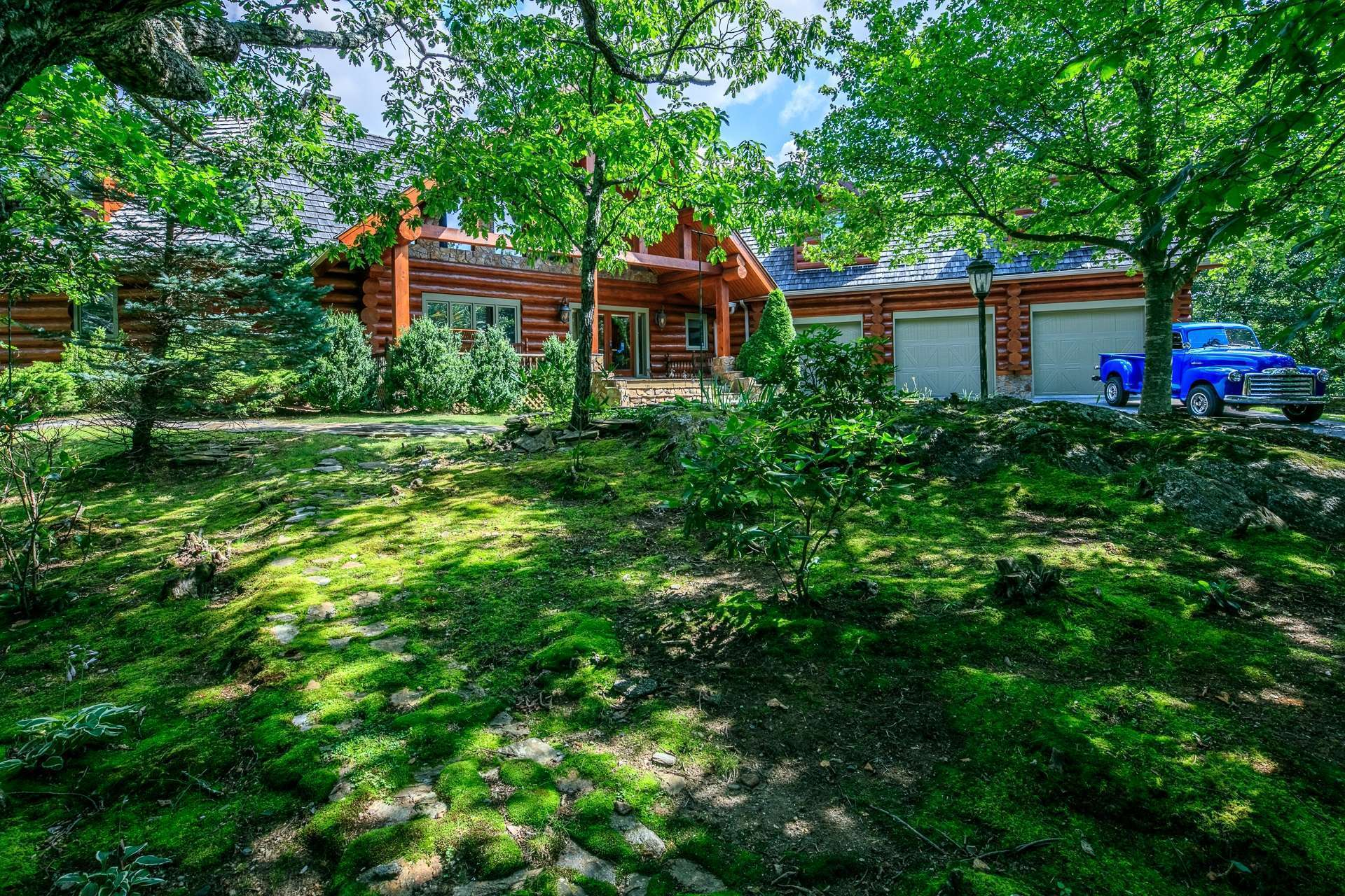 Majestically sited on a naturally forested 19.06 acre setting in the Todd area of Southern Ashe County, this log home offers fabulous curb appeal and plenty of parking space including a three car garage.