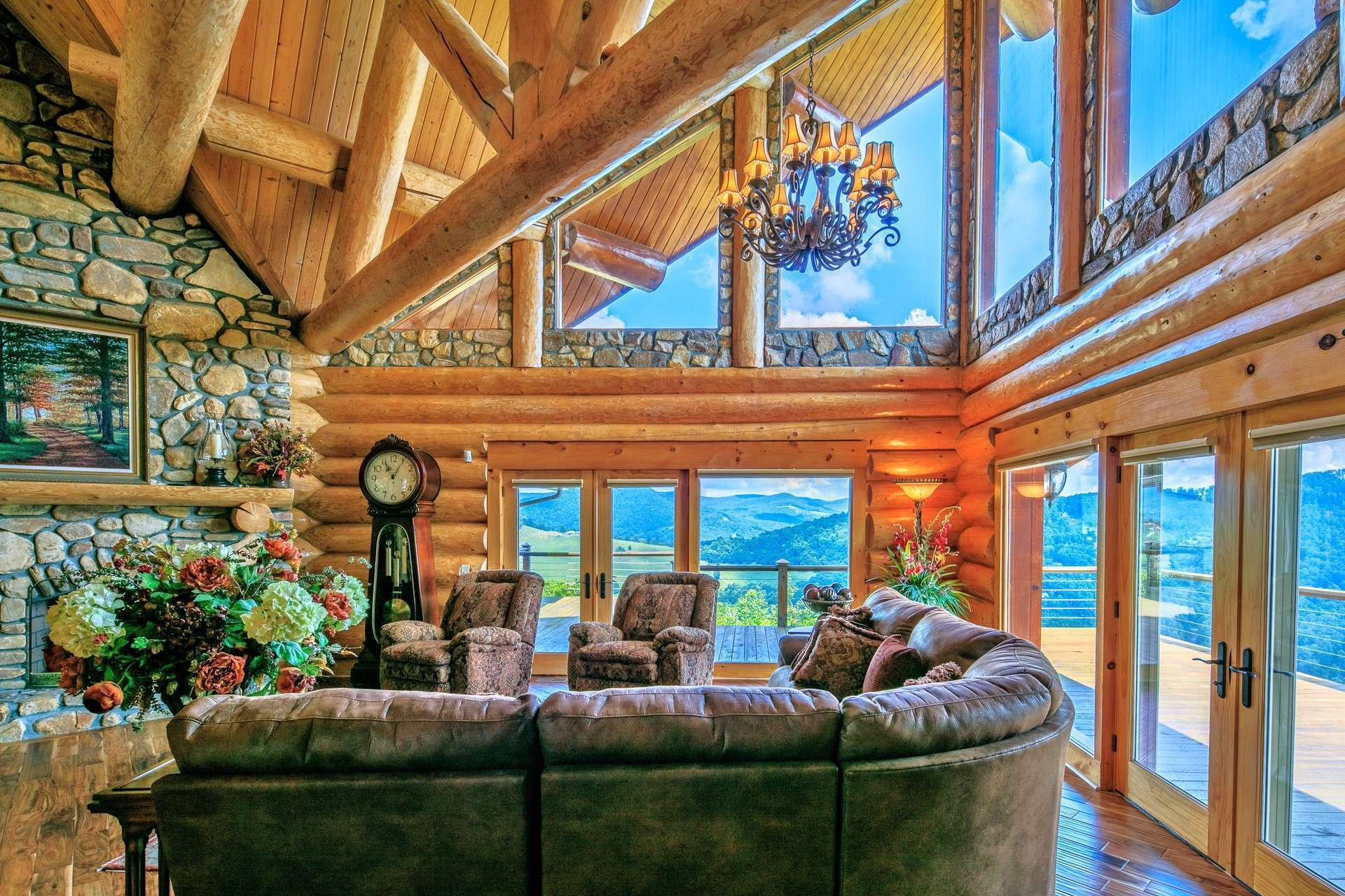 The high vaulted ceiling highlights the exposed log beams while the vast wall of windows fill the cabin with natural light and enables you to enjoy the great outdoors throughout all four seasons in the majestic Blue Ridge Mountains.