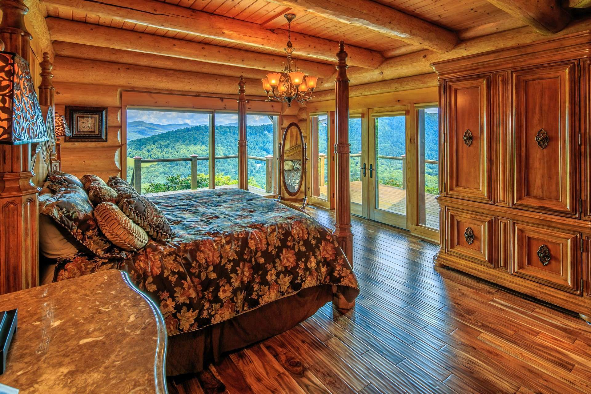 The main level owner's master suite maintains an ambiance that exudes warmth and charm. Large windows along with French doors flanked by more windows provide natural light and access to the deck, while...