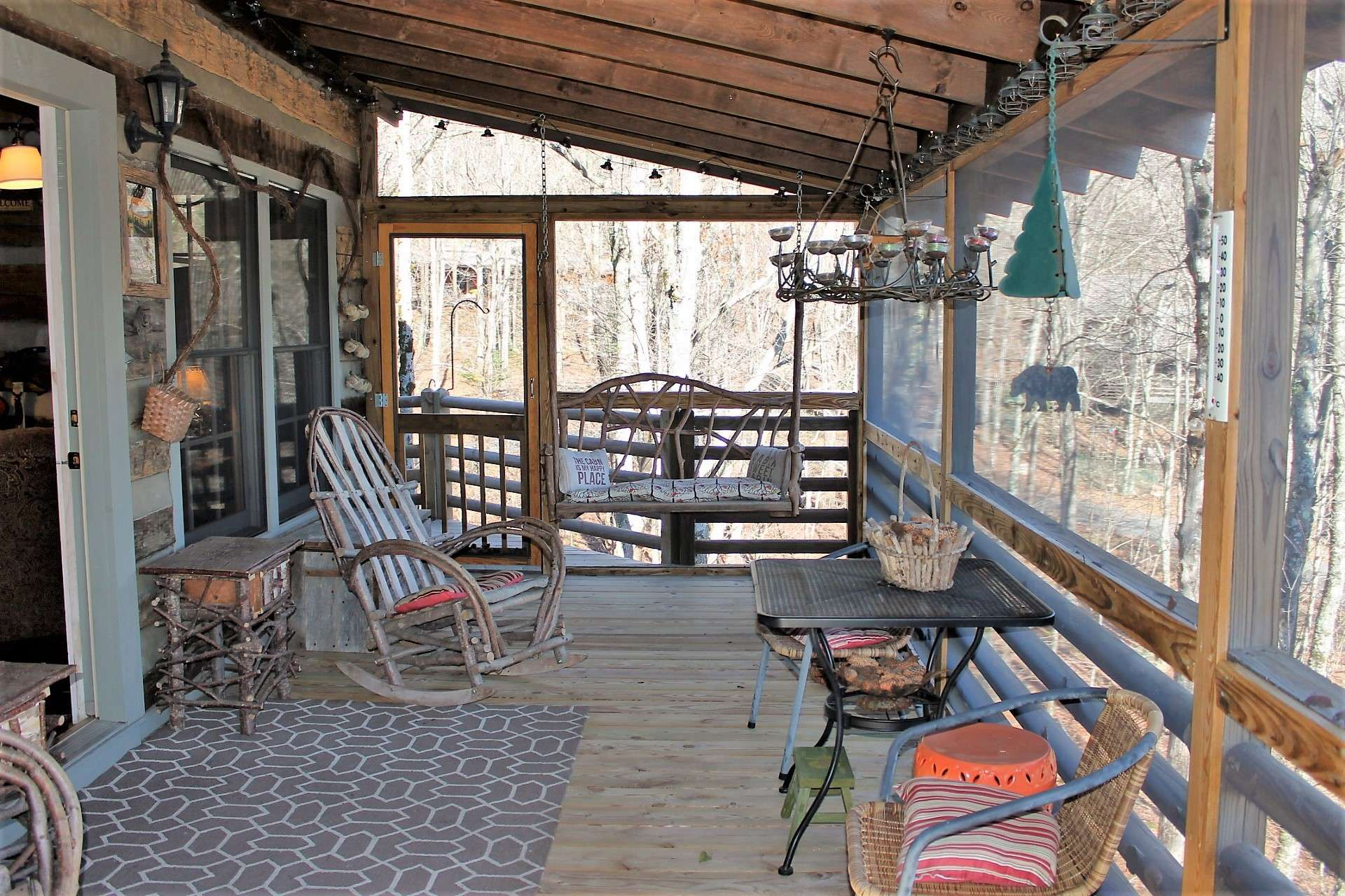 The covered screened porch is ideal for sitting in a rocker or swing sipping your favorite beverage and enjoying the cooler mountain temperatures.