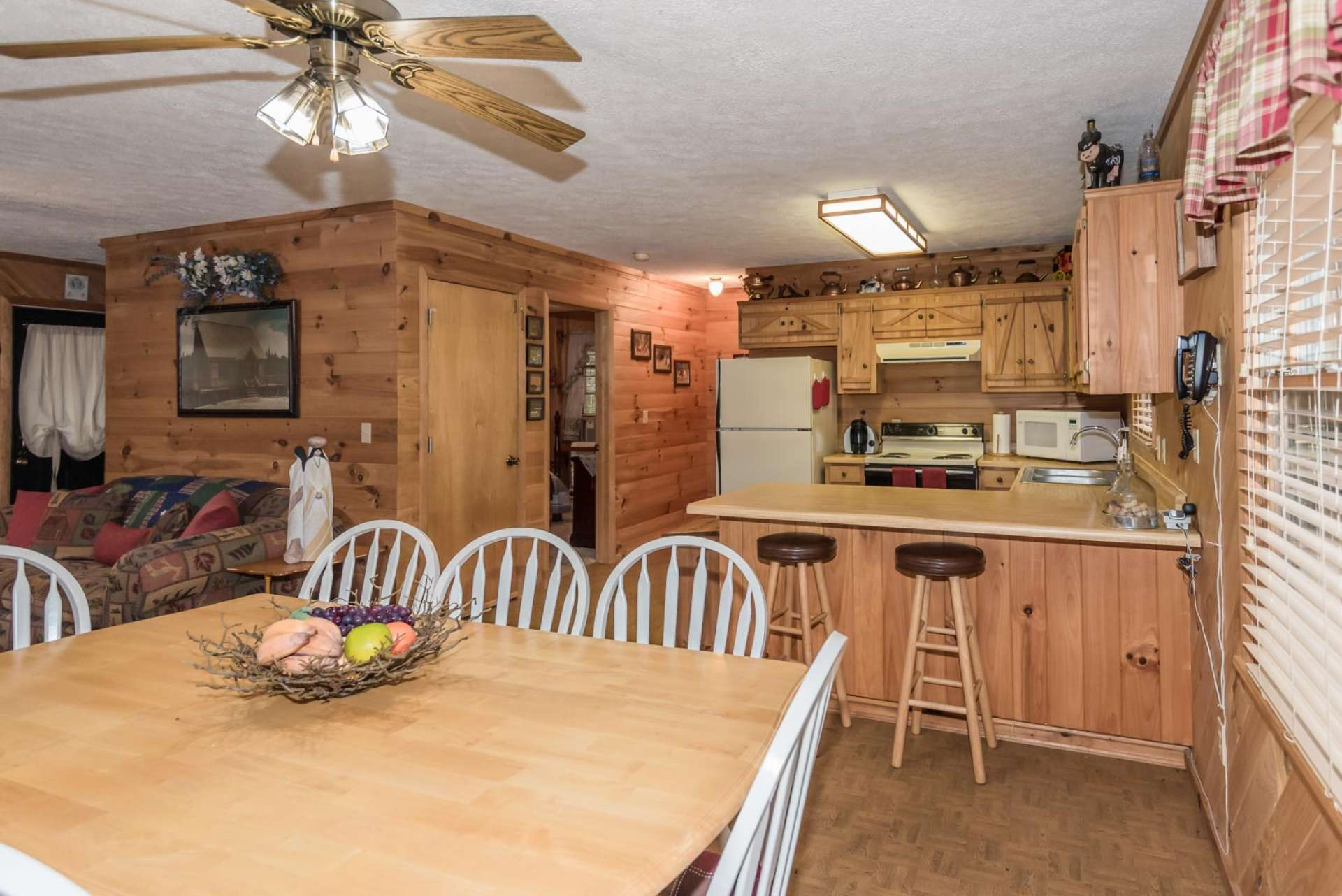 The kitchen area is efficient with ample work and storage space.  There is also plenty of room for help in the kitchen.