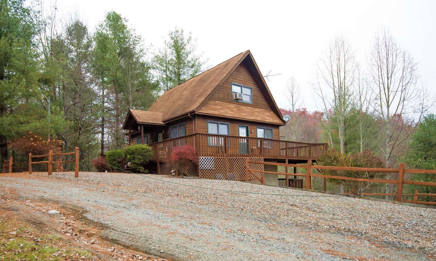 BLUERIDGE MOUNTAIN CABIN nestled on a peaceful .82 acre setting on Happy Forest Drive in the River Lake community of Piney Creek in Alleghany County, this 2-bedroom, plus bonus room, 2-bath cabin is a great option for your mountain retreat or primary residence.