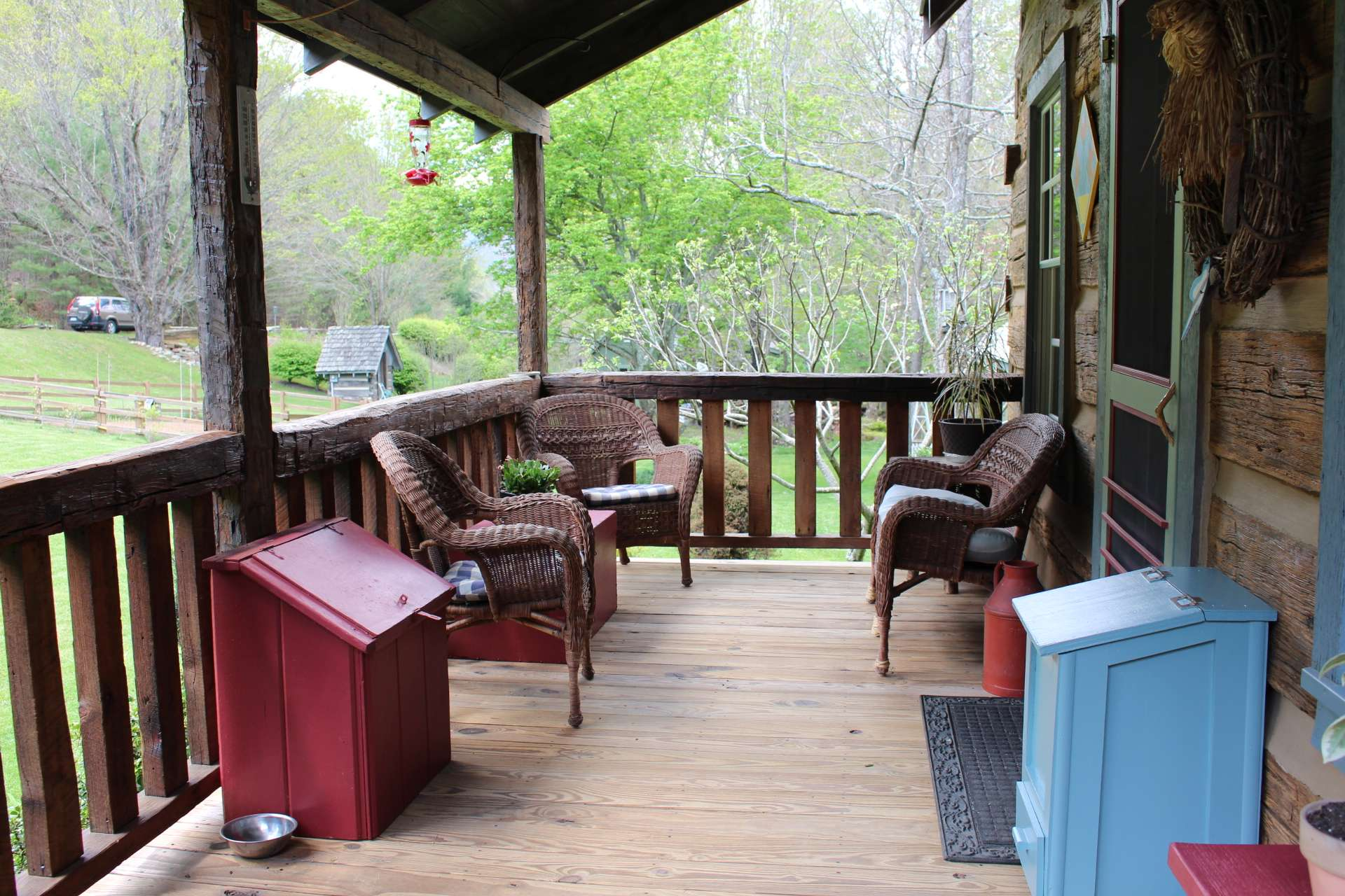 Enjoy the views and the sounds of a noisy little creek while sipping iced tea on the nice covered front and side porch.