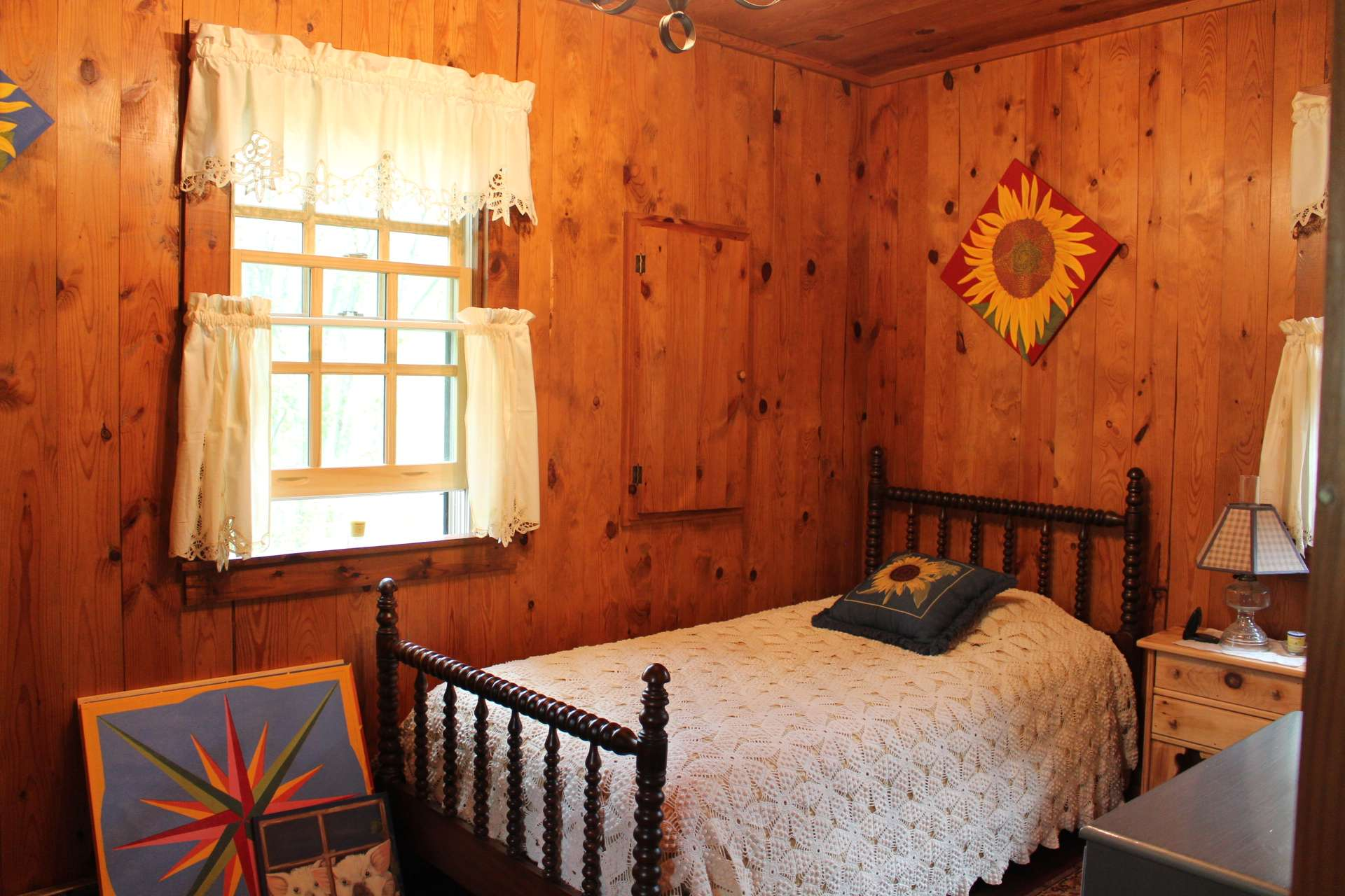 A guest bedroom and full bath complete the main level of the cabin.