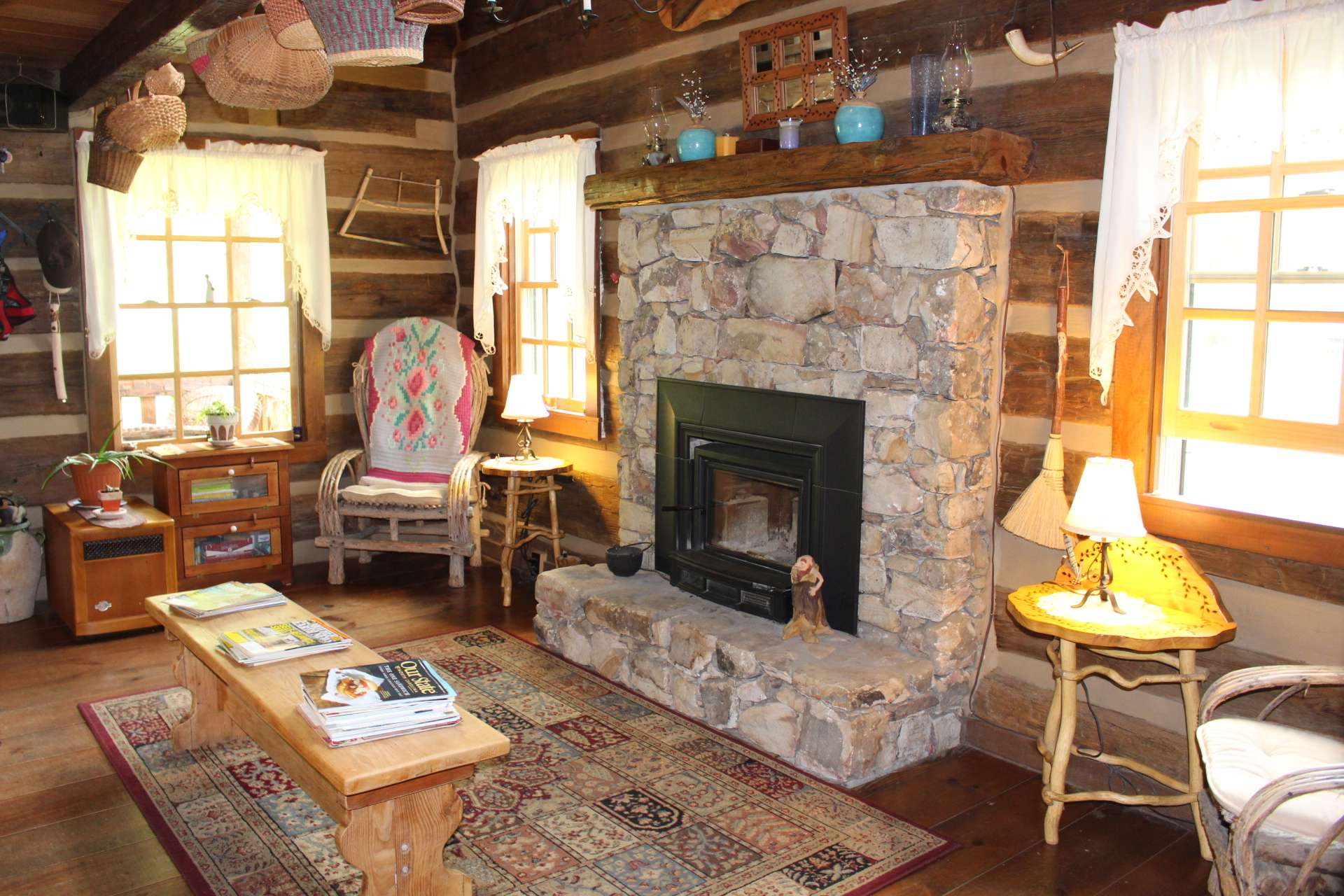 This log cabin is designed to warm your hands and your heart with the stone fireplace in the vaulted great room.