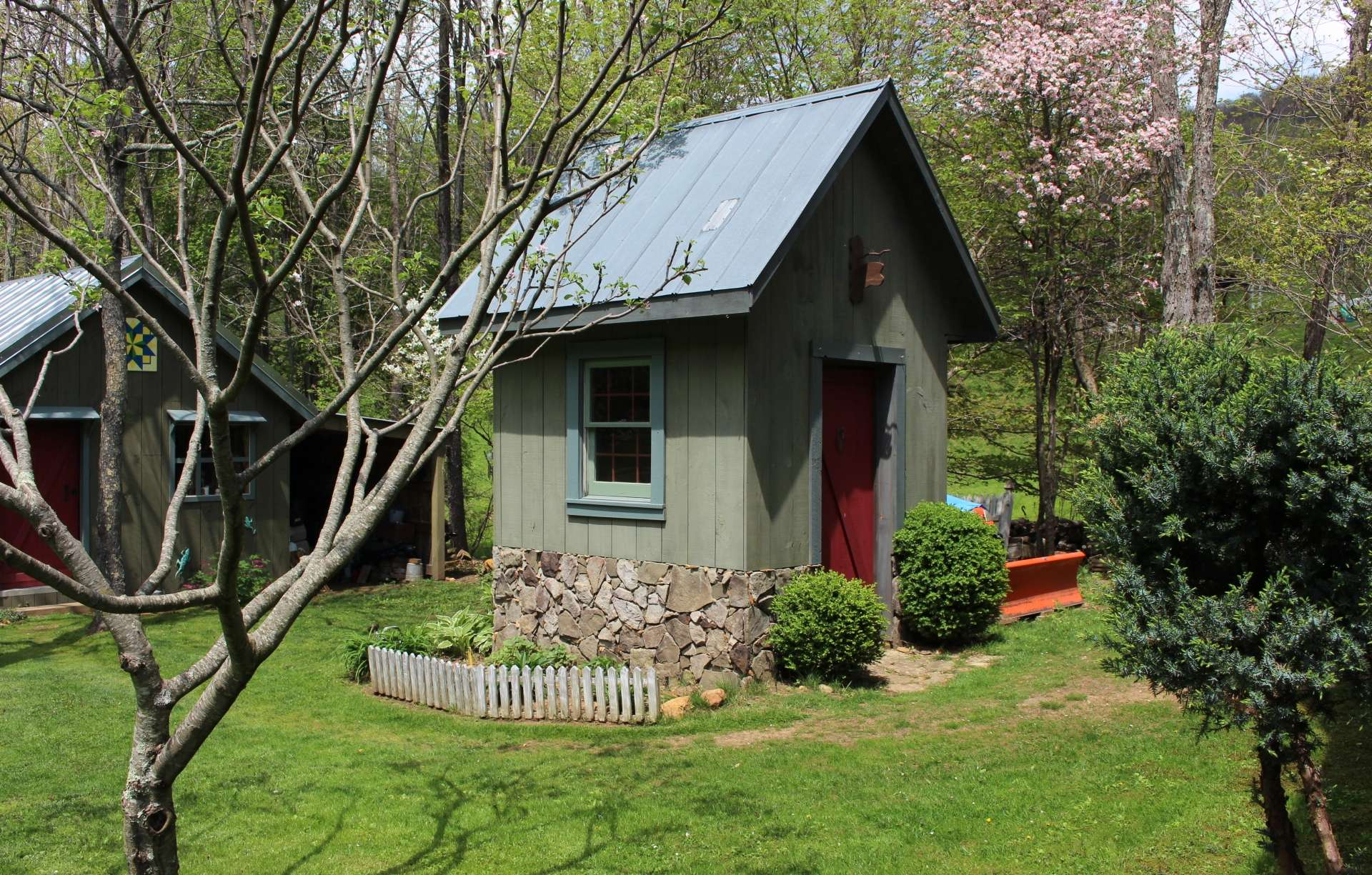 This cute milk room outbuilding will work nicely as storage or potting shed.