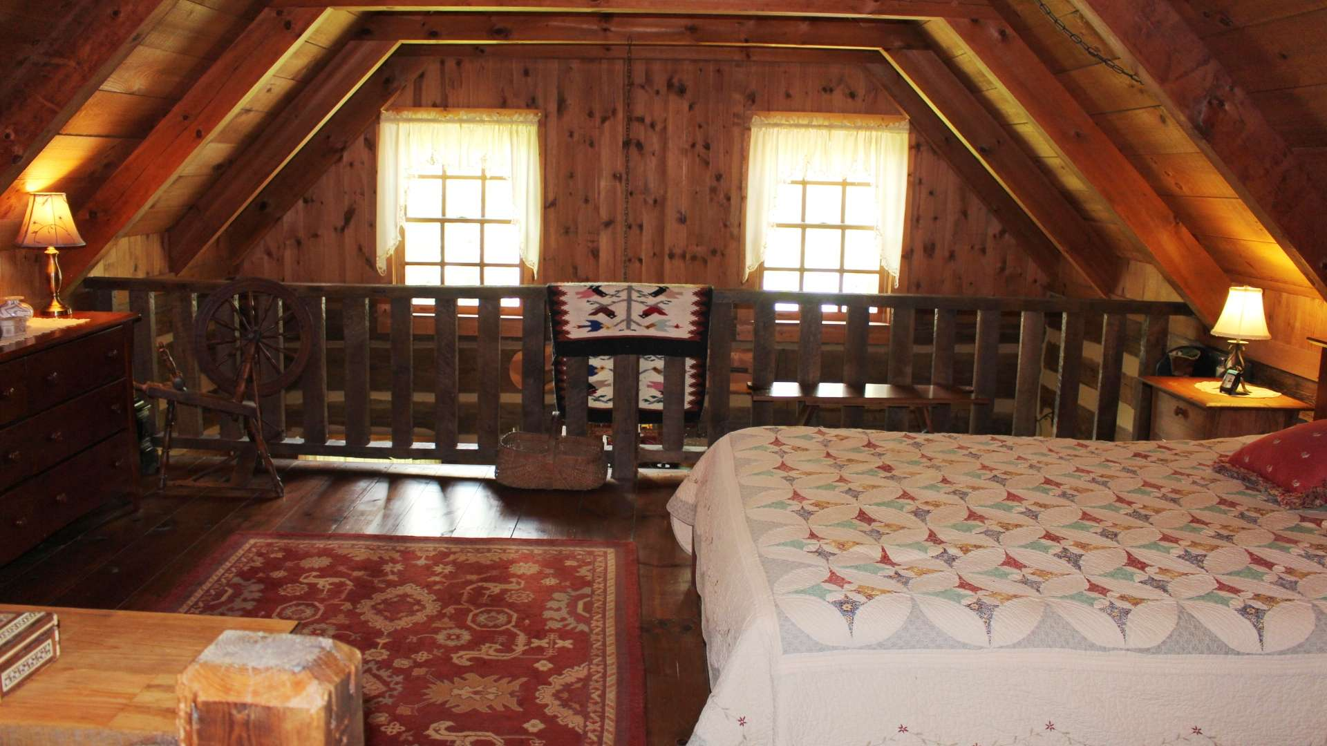 The upper level loft area overlooks the living area and currently used as the master suite.