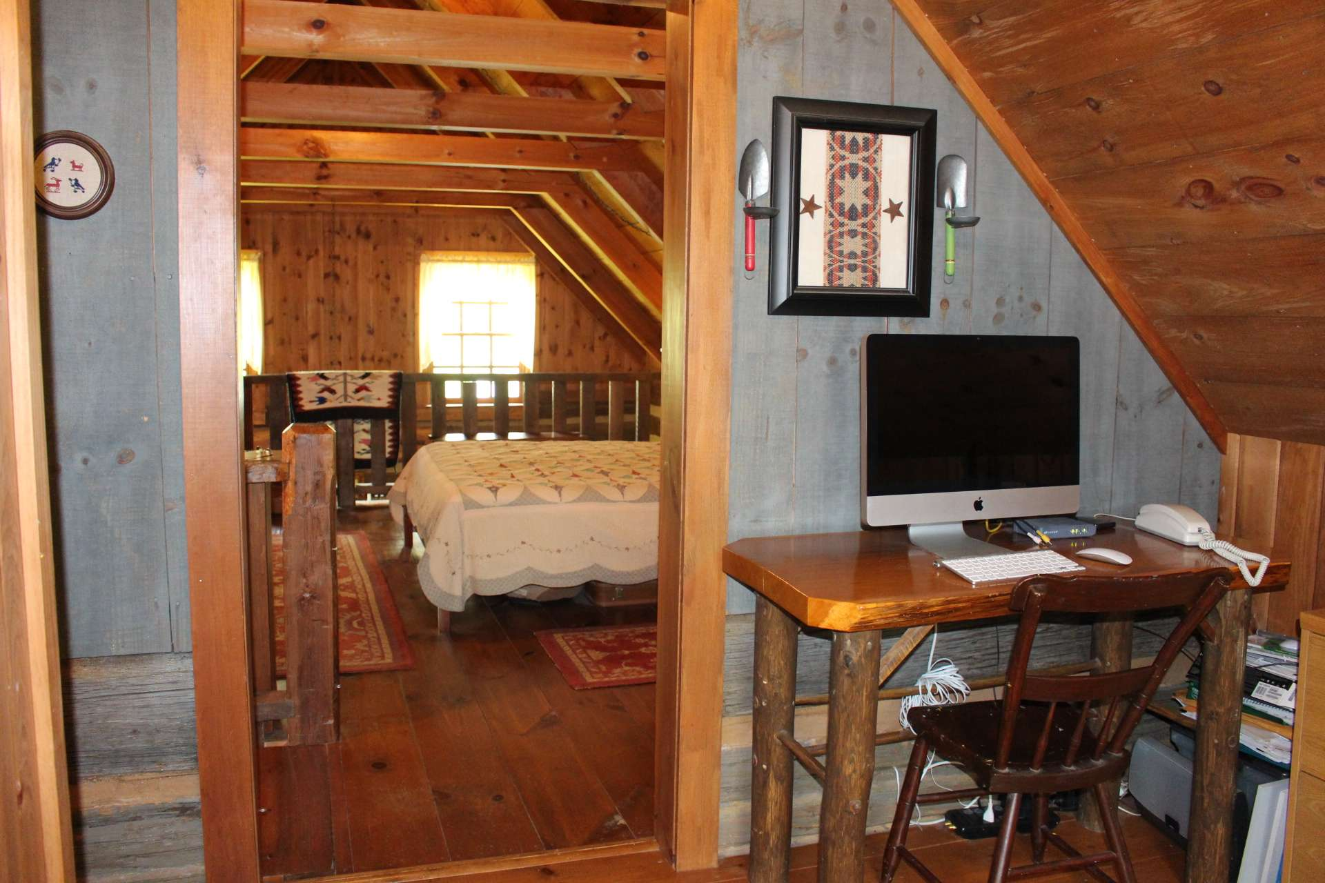 Just off the bedroom/loft is a sitting area/office and a full bath with claw foot tub.