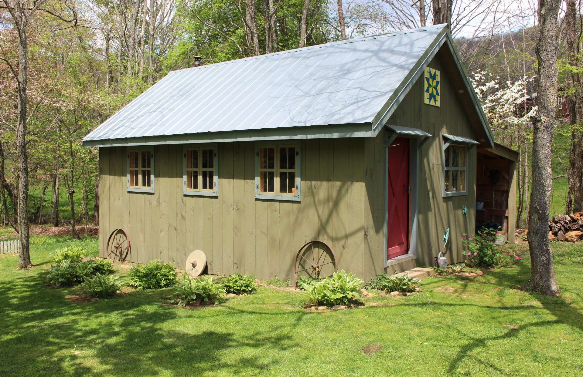 This craftsman style outbuilding offers multiple possibilities as workshop or bunkhouse.