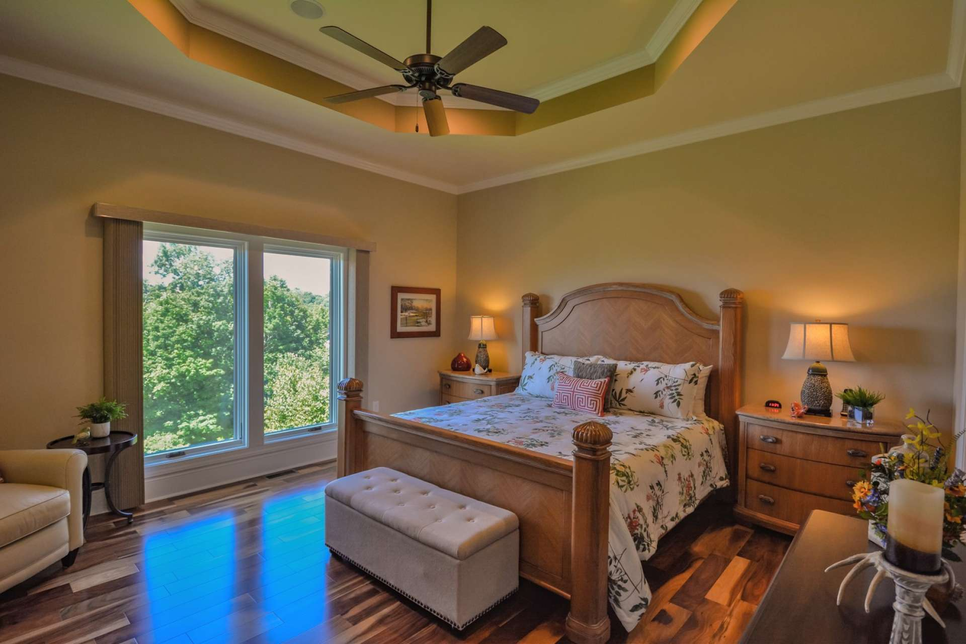 The magnificent master suite includes a trey ceiling and ceiling fan. Of course you'll find stunning views from the bedroom windows.