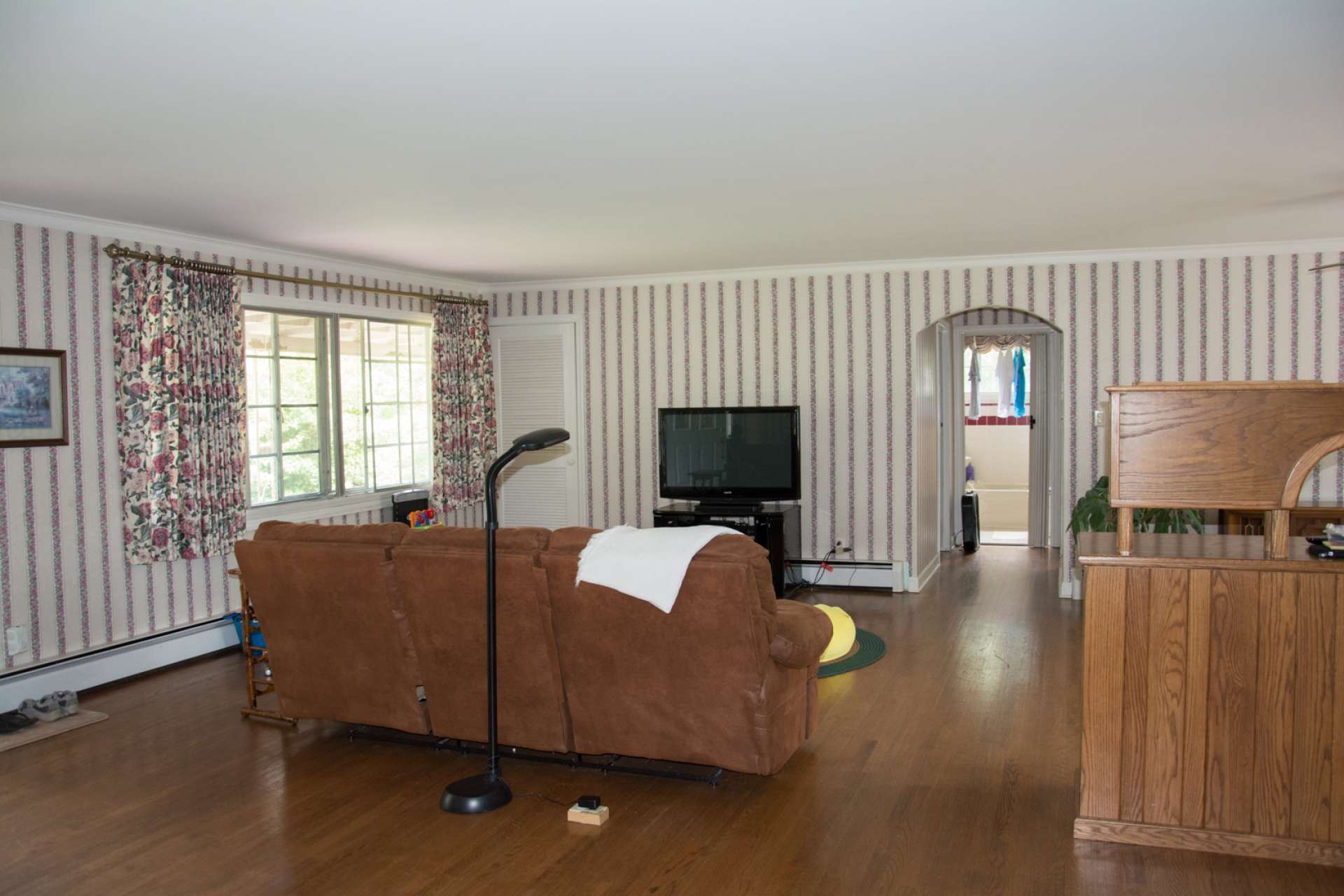 The main level offers a spacious living area with hardwood floors and a wood-burning fireplace.