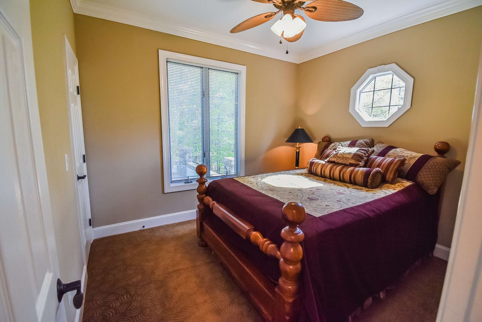 The main level guest bedroom is spacious with comfortable carpeted floor.