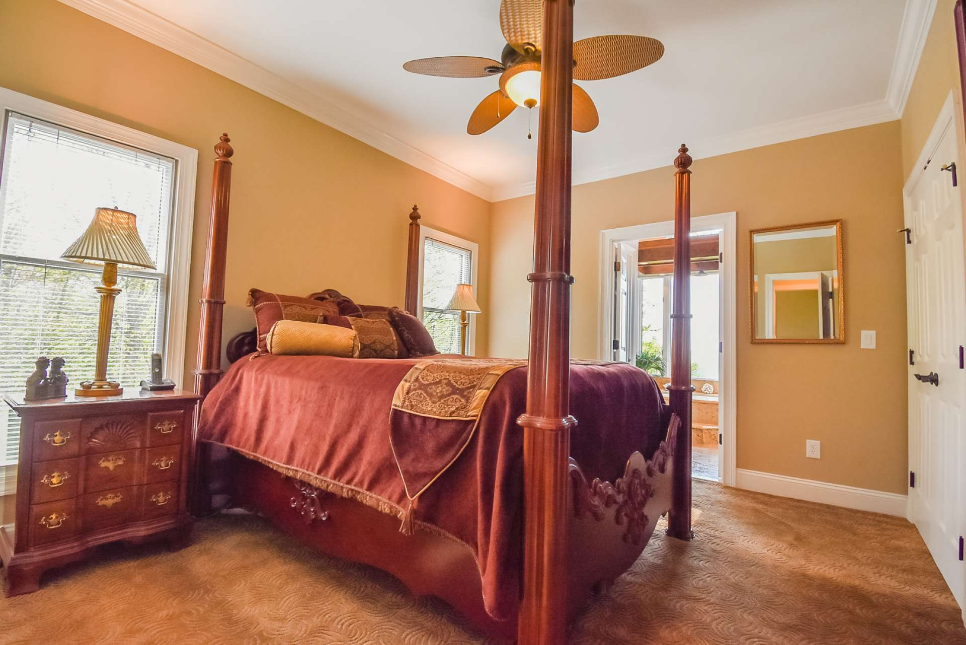 The main level master suite offers built-ins and a private master bath with access to the back deck.