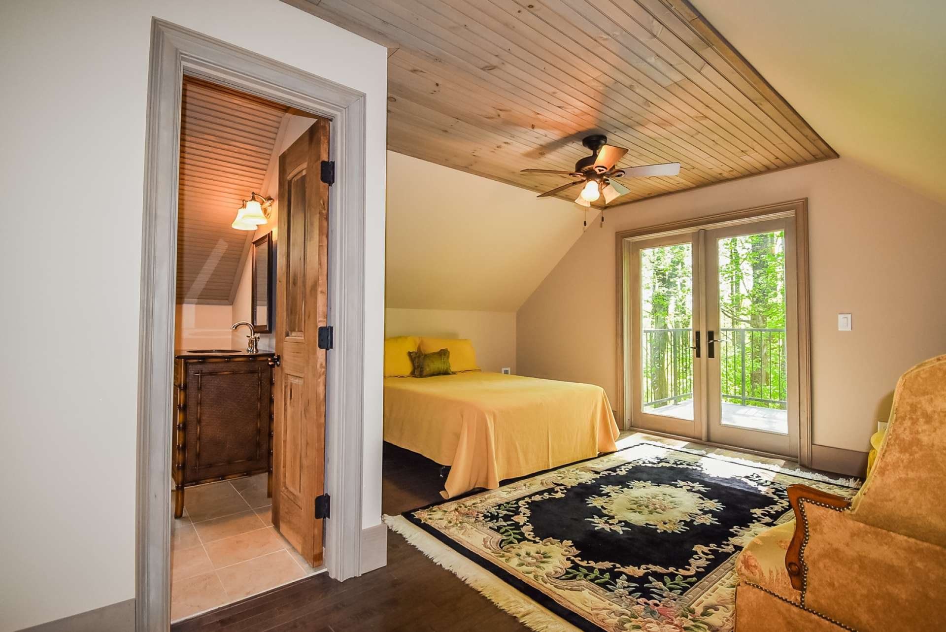 The apartment bedroom features access to a private deck. Your guests will enjoy their privacy.