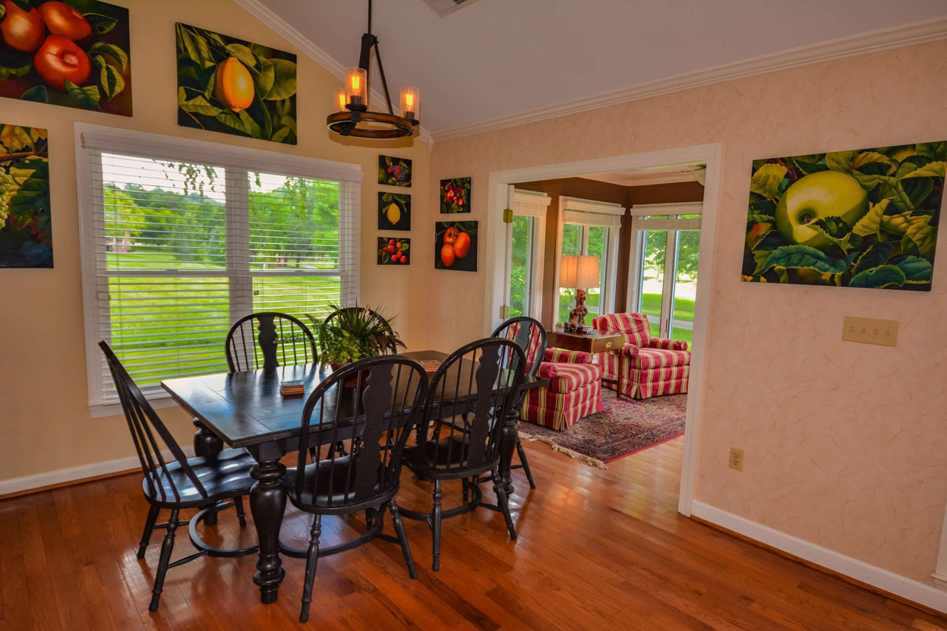 The formal dining area offers a pleasing dining experience and opens to a light filled sun room.