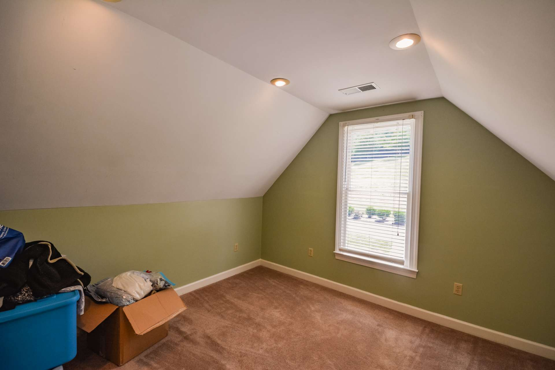 The upper level bedroom is currently utilized as storage space and could also be a home office or library.