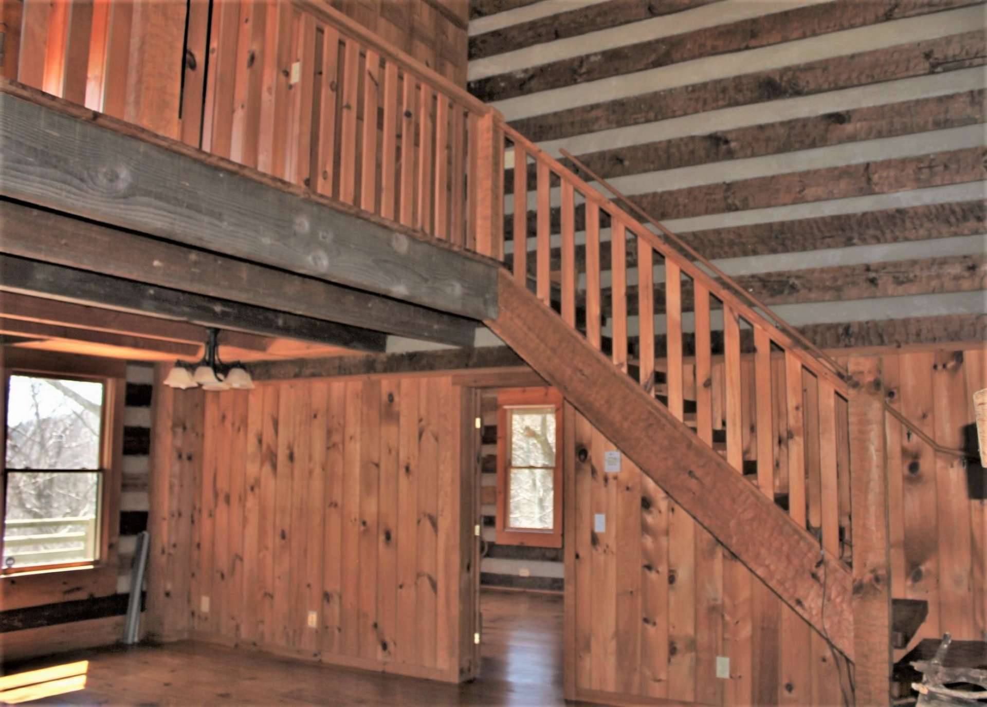 The hand-hewn staircase leads your guests to the bedroom loft area.