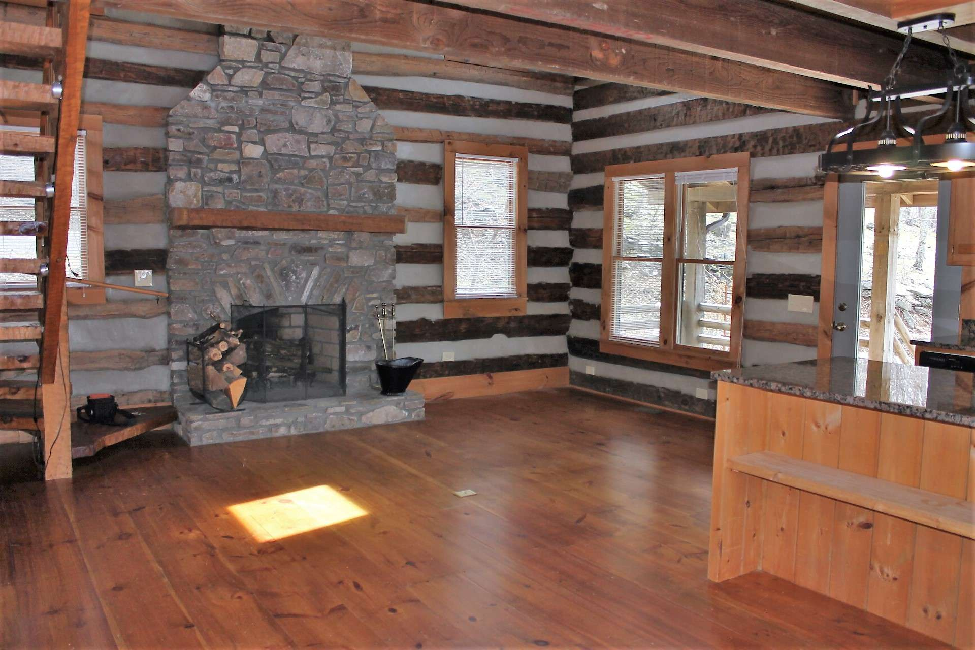 The interior features an open floor plan with wide-plank wood flooring throughout.