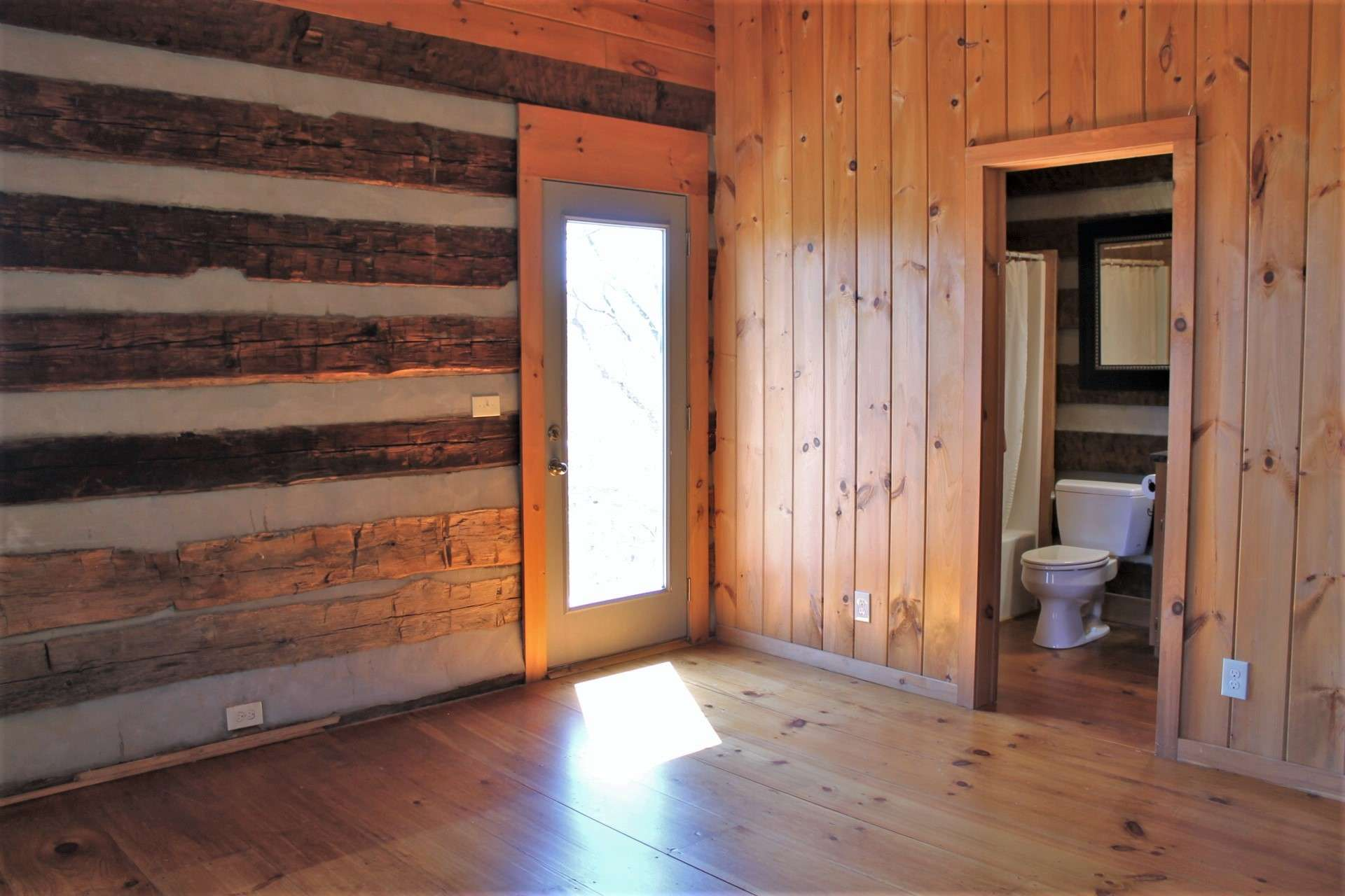 This upper level loft area features a private bath and access to the upper level deck.