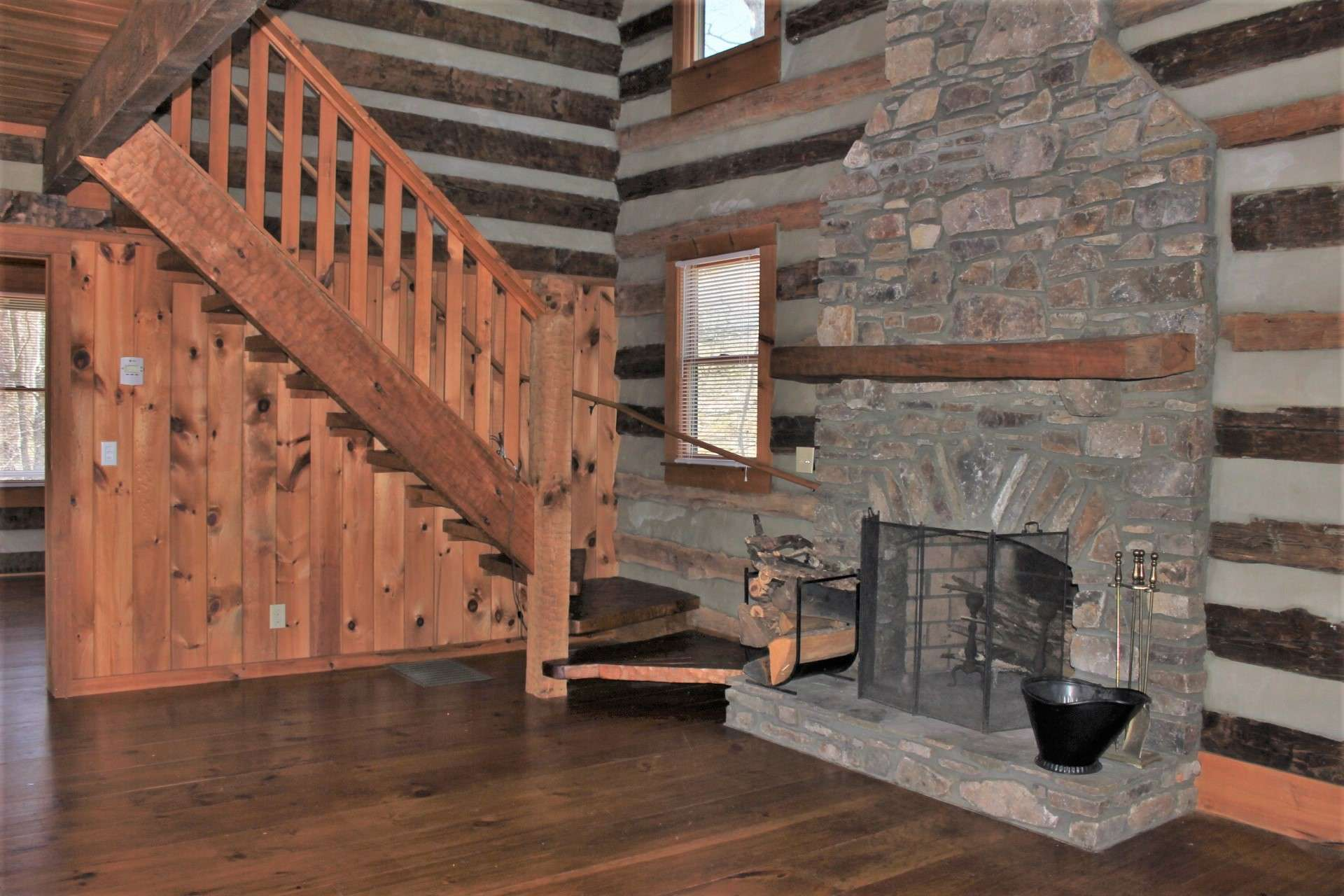 The great room is warm and inviting with rustic details that enhance the experience of log home living.
