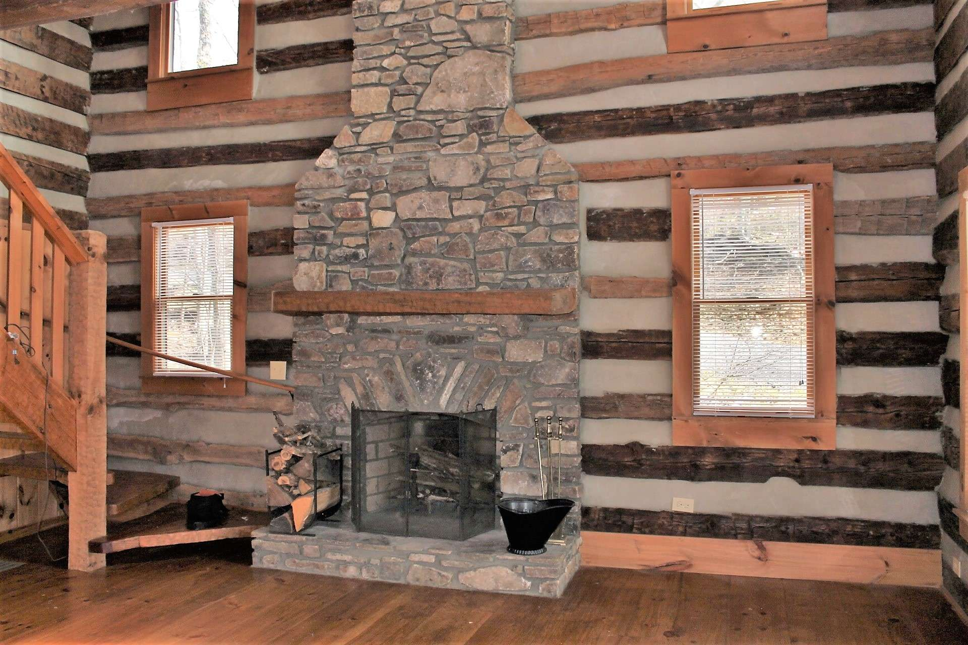Four windows flank the fireplace to bring in ample light.