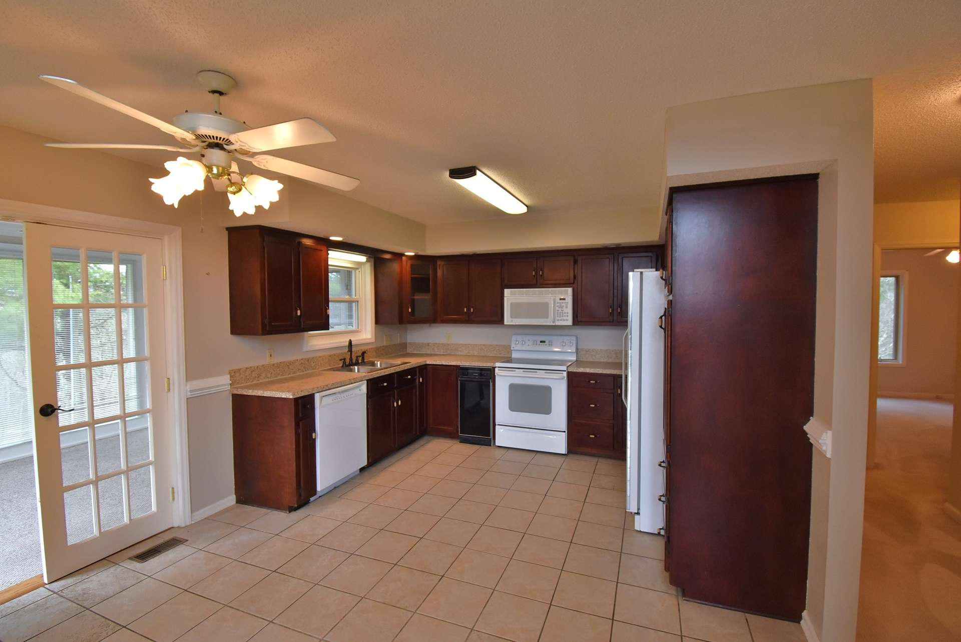 The kitchen is open to the dining area and offers easy access to the sunroom.