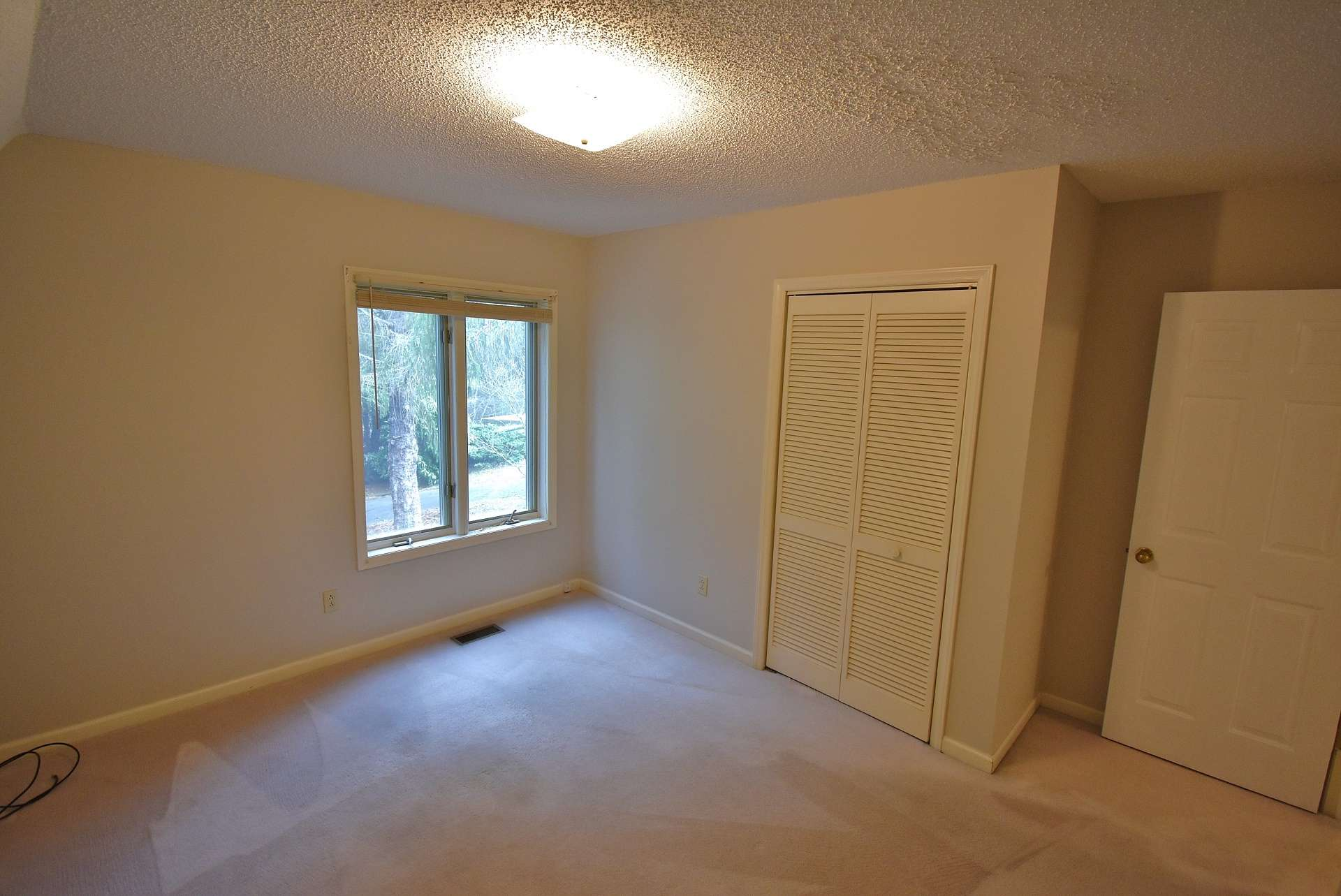 The two main level guest bedrooms are both spacious, light filled, and offer comfortable carpeted flooring.