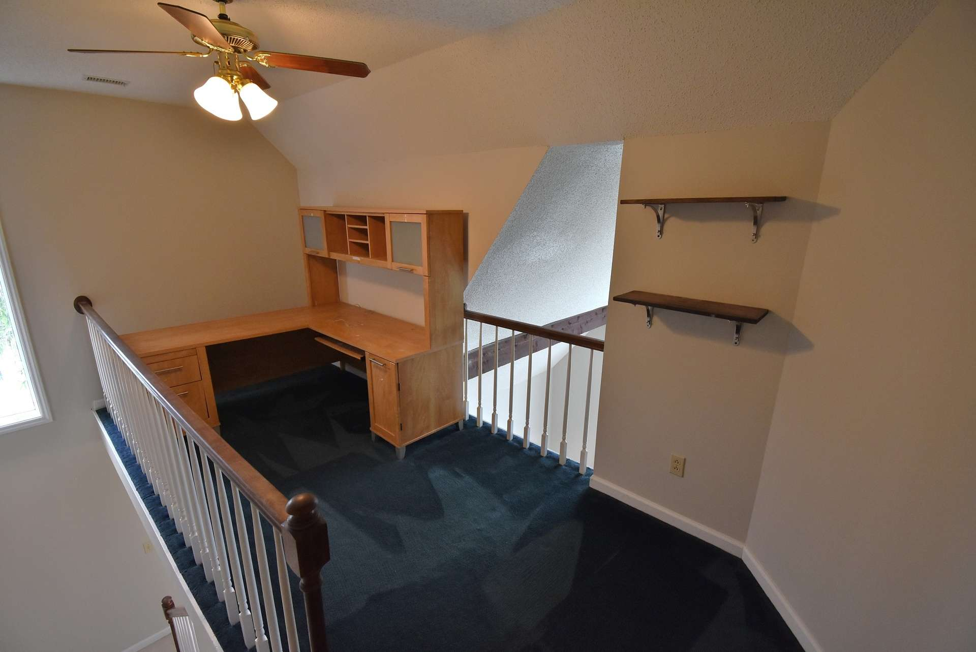 The upper level offers this loft area overlooking the living room.  This would be a great space to utilize as an office area or library.