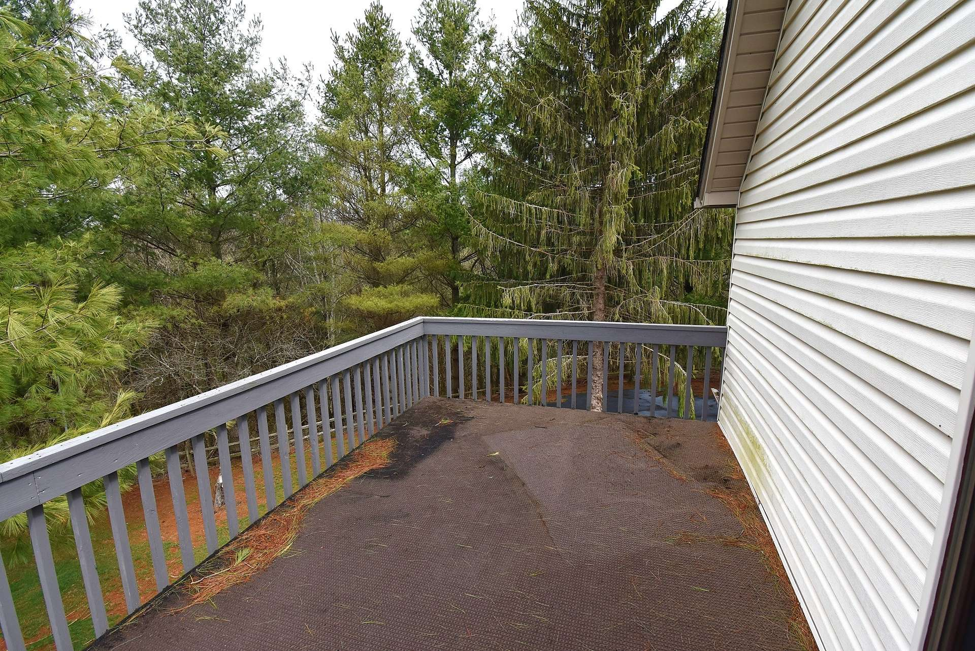 This upper level deck is accessed from the master suite.  Enjoy your morning coffee with the views and fresh mountain air, or relax in the evening with a blanket of stars above you.