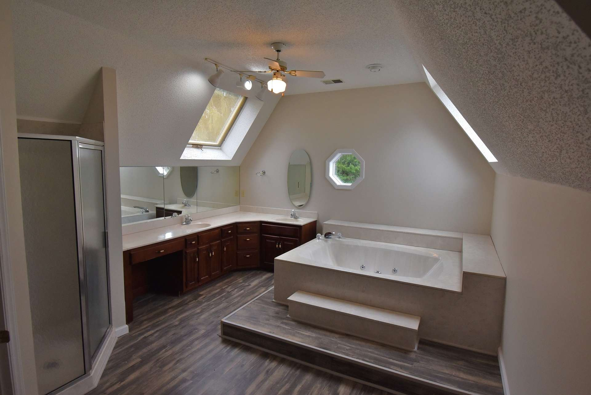 Enjoy a spa-like experience in the master bath with long double vanity, skylights, jetted tub and walk-in shower.