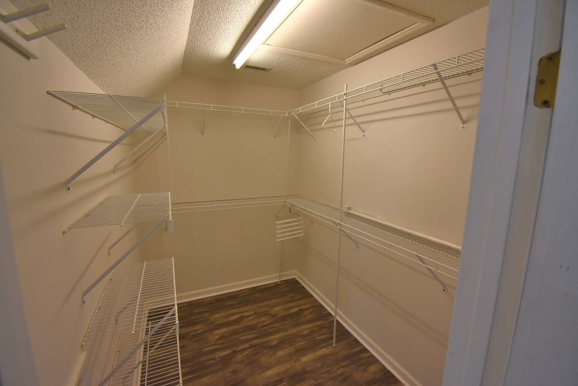 So much storage space in the master bedroom closet.