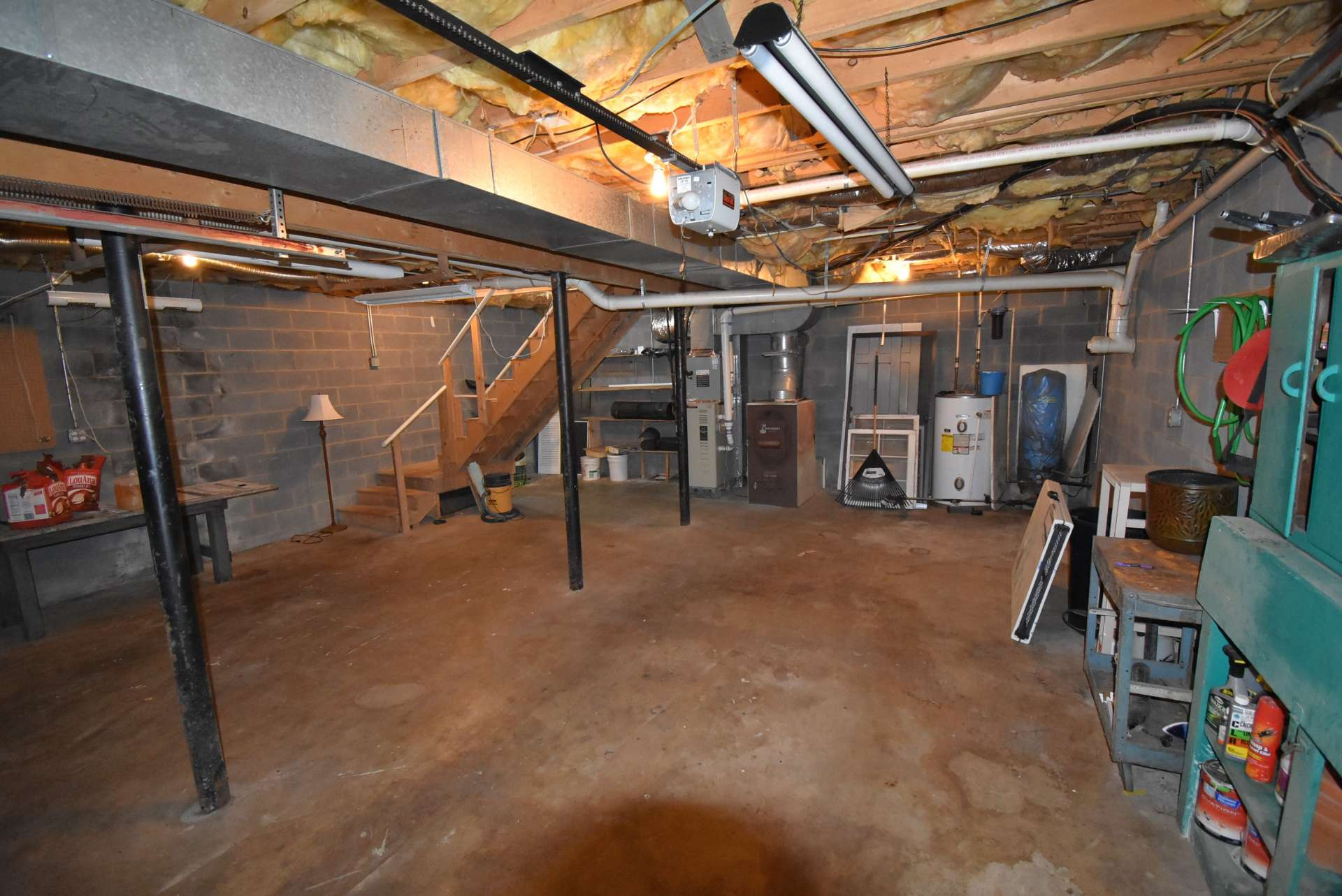 A full walk-out lower level offers lots of storage space, workshop area, garage and expansion potential.