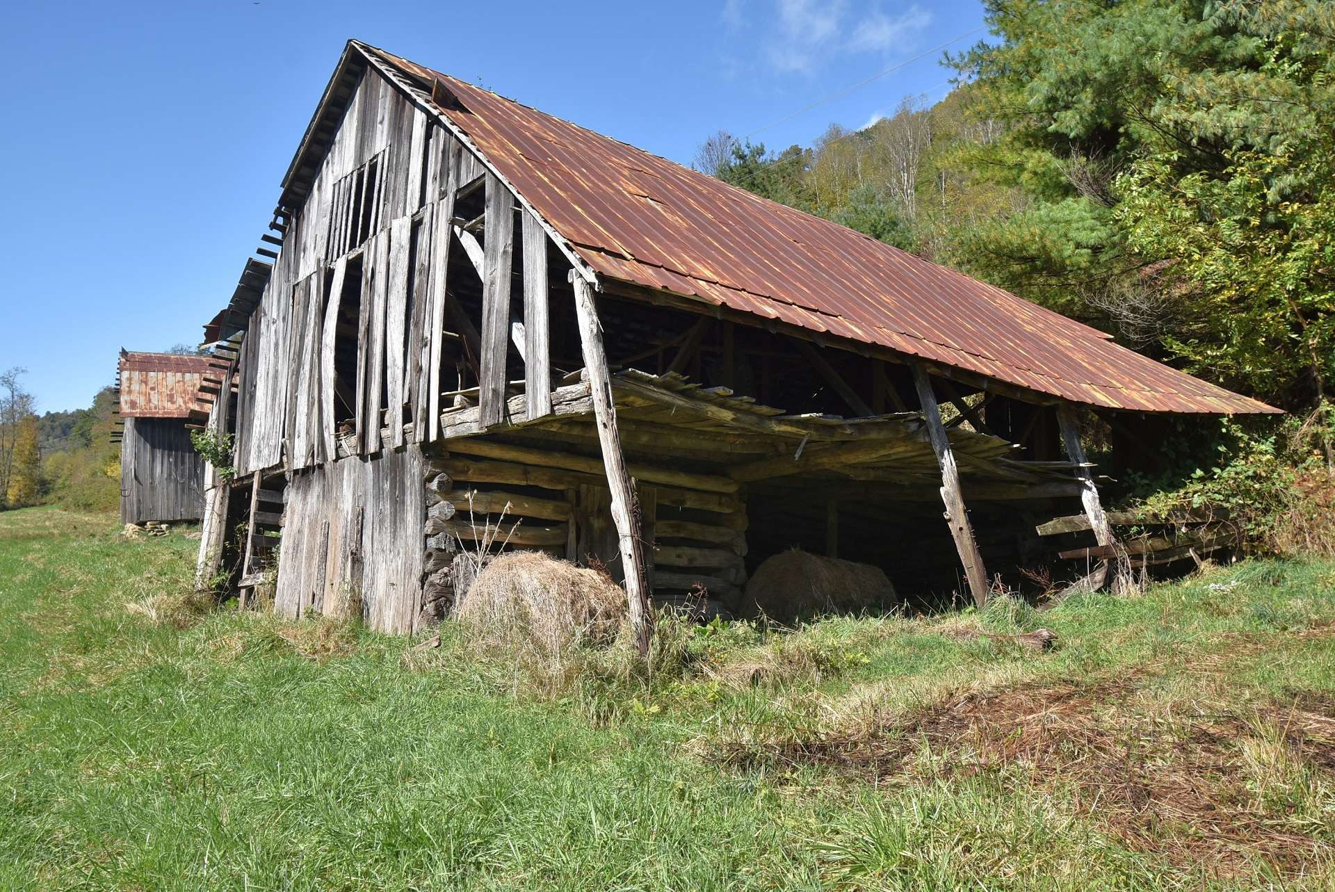 This farmstead barn shows off its vintage log beginnings.