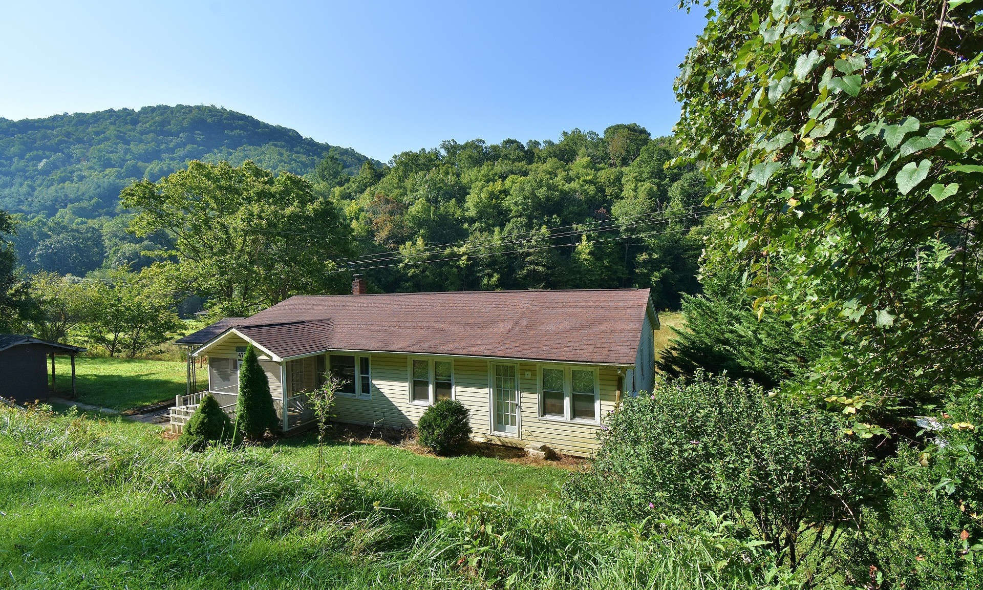 COUNTRY LIVING! Enjoy country living with room to roam on this 70 acre farm in the Lansing area of Ashe County in the NC Mountains.