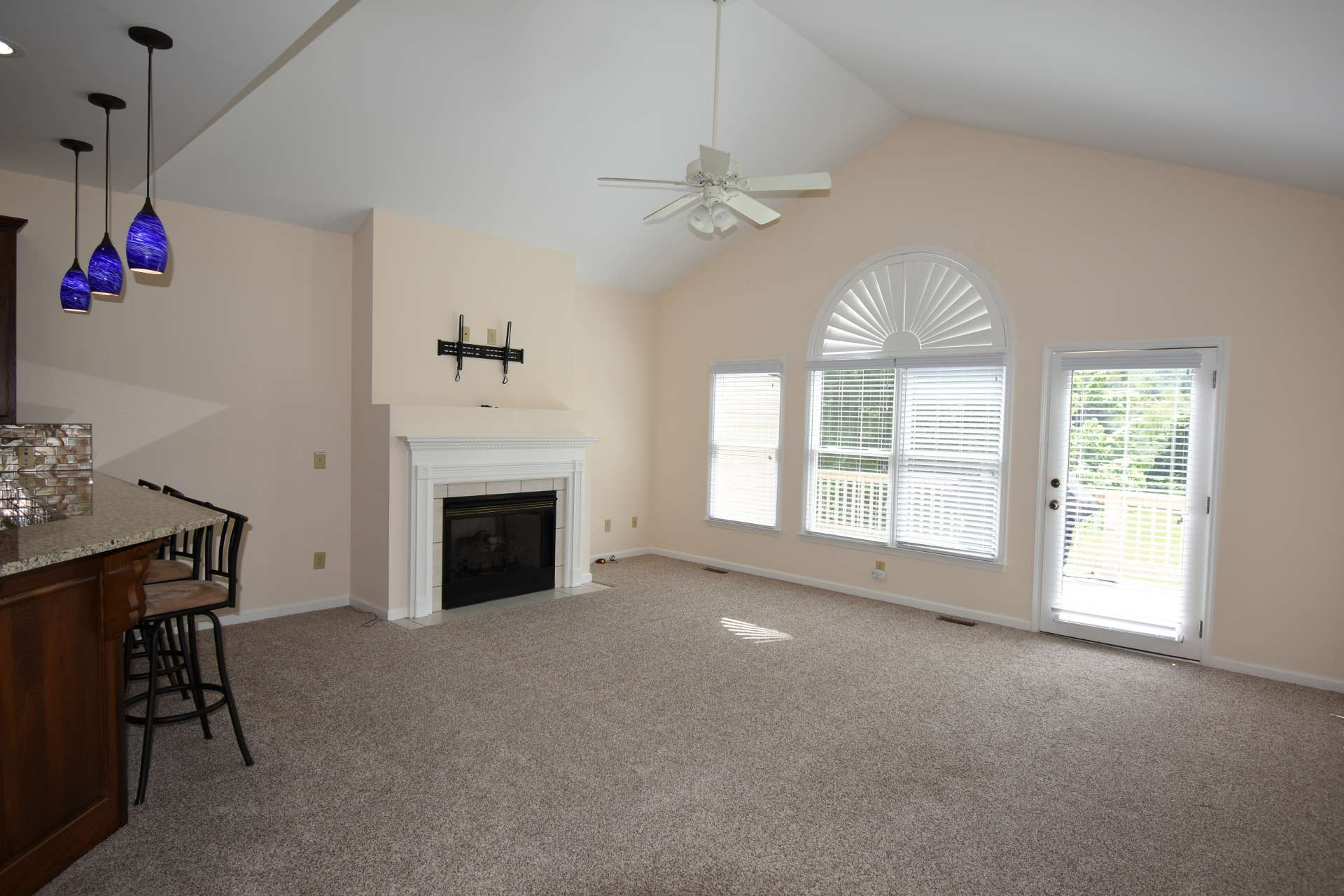 The open floor plan includes a vaulted great room with lots of windows to fill the space with natural light, a cozy gas log fireplace and comfortable carpeted floors to warm up those cool winter evenings in the mountains.