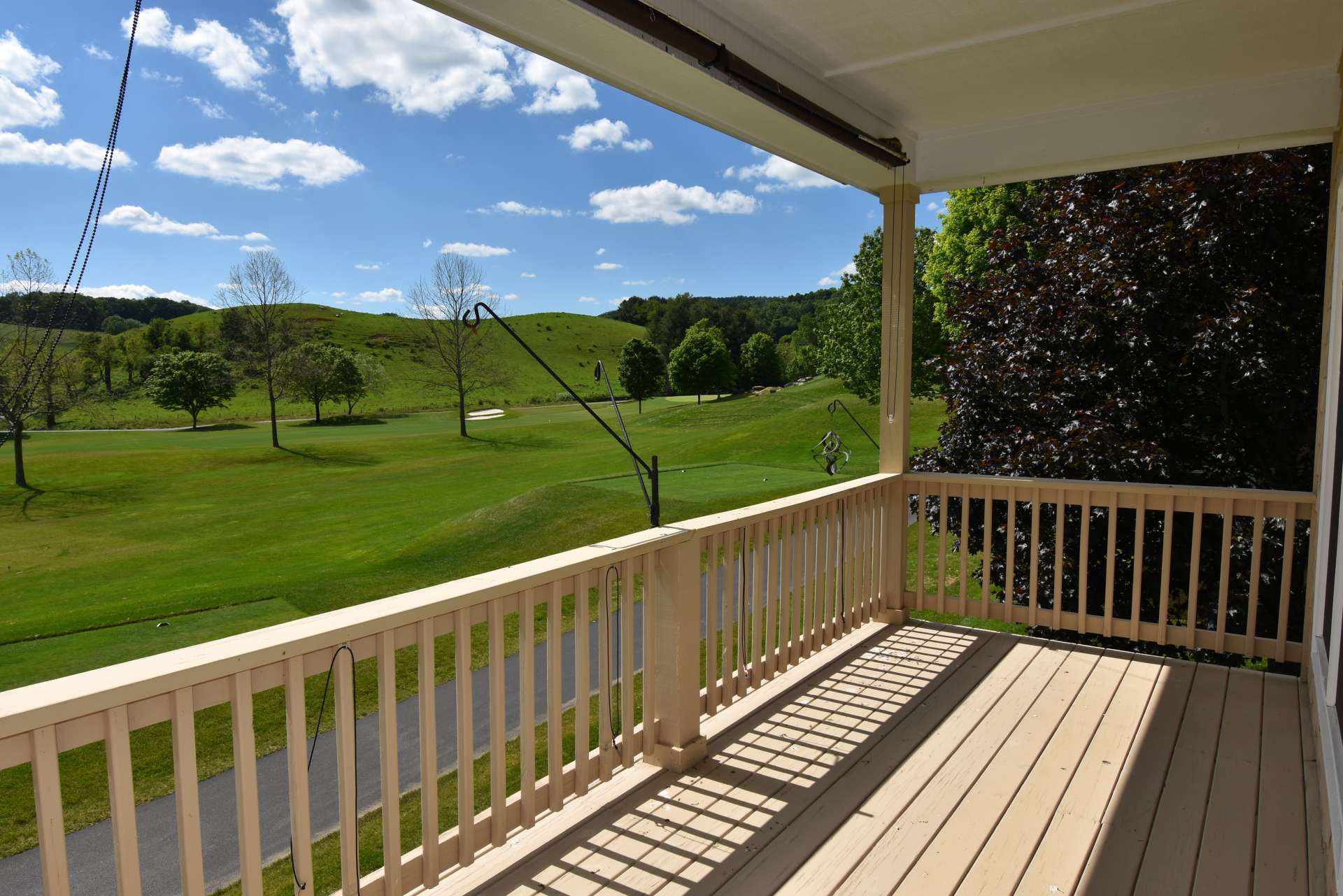 The main level also features a partially covered deck for outdoor entertaining with the fairway and mountain views.