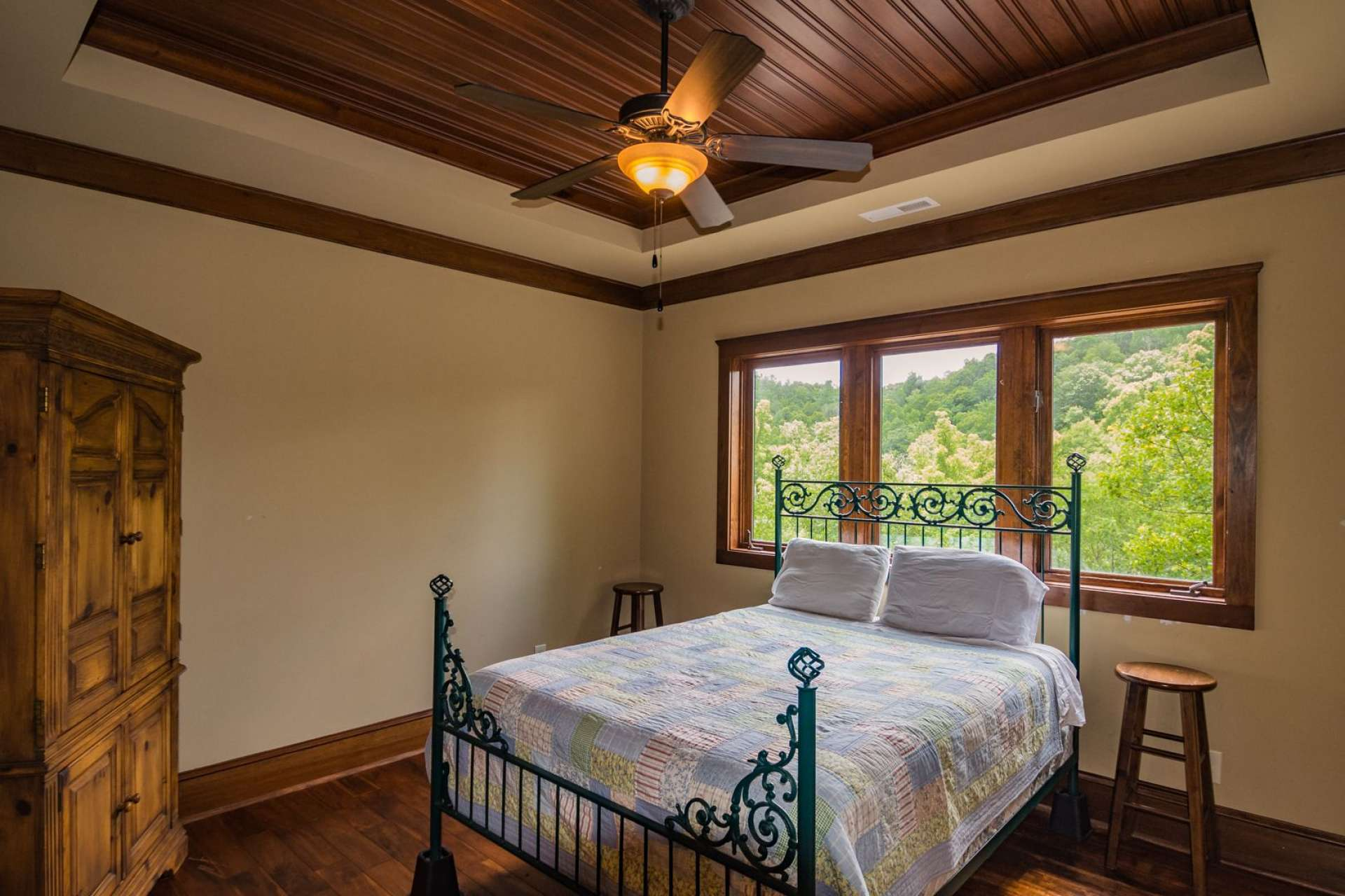 The beautiful floors and details like the ceilings continue to the upper level where you will find three bedrooms and three baths.