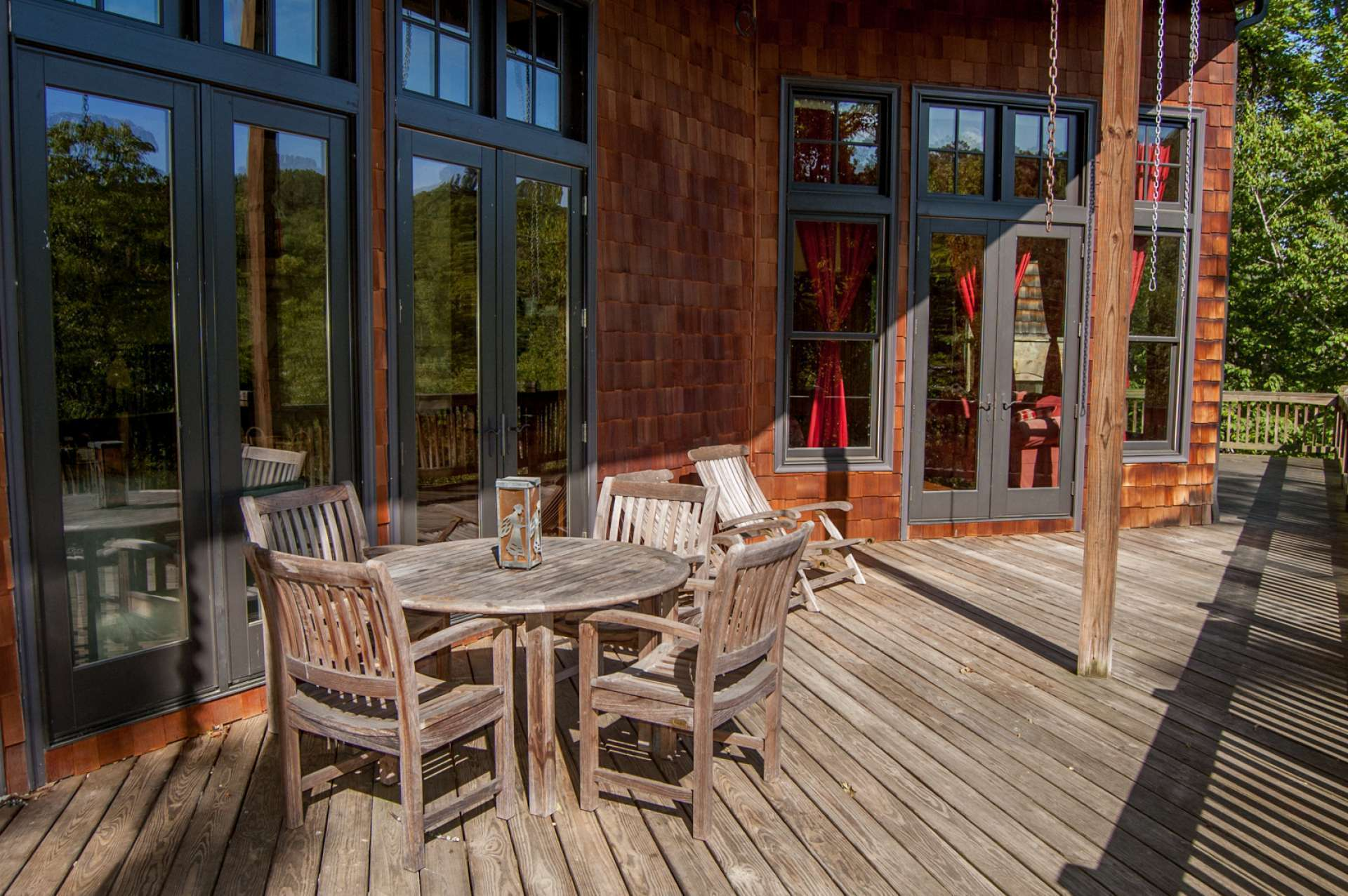 The main level offers both covered and open decking to enjoy outdoor entertaining or simply relaxing by the outdoor fireplace with the setting and the river below.