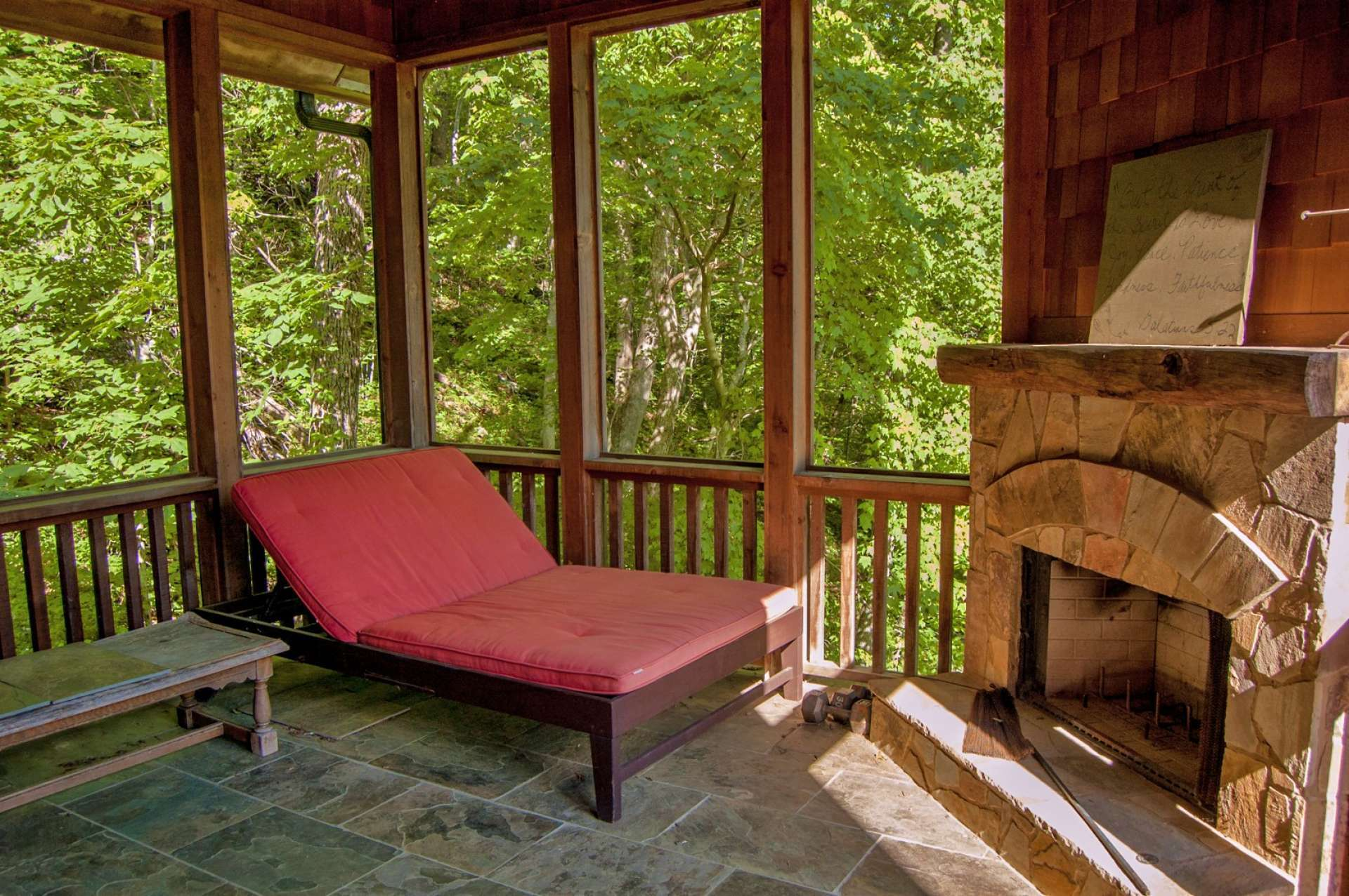 Just off the master bedroom, this private covered porch is the perfect spot to relax at the end of the day in front of the outdoor fireplace.