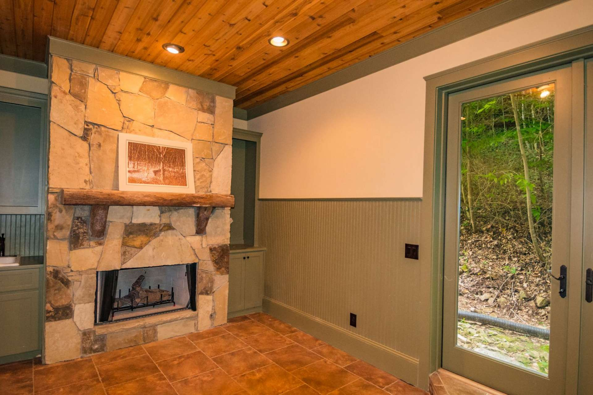 In the master suite wing, you will find this bonus room with fireplace and built-in cabinets that current owners used as a studio. You can utilize this space for any number of uses.