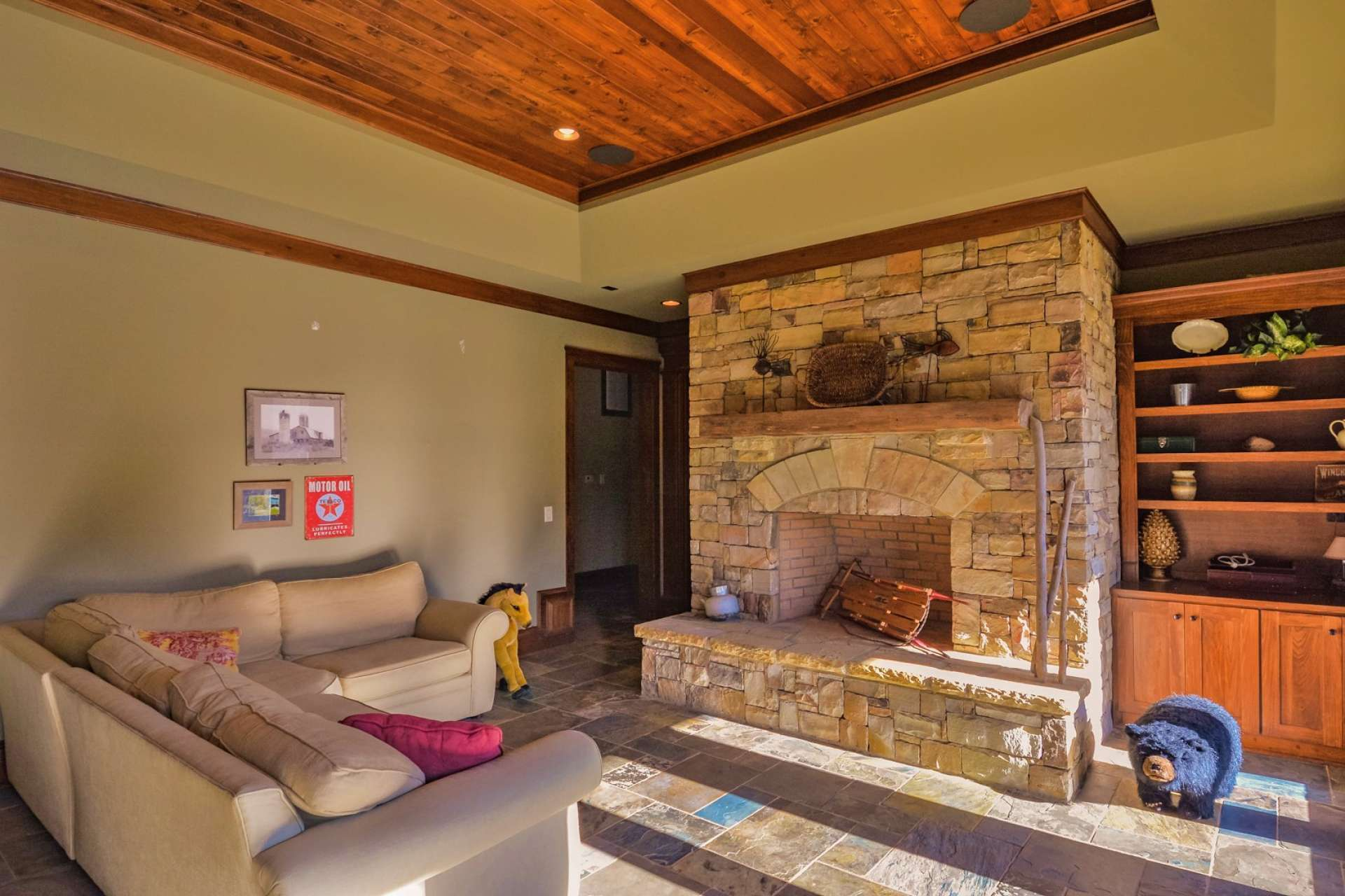 The full walk-out lower level offers a family room with another wood burning fireplace, more built-ins and it's own bar, plus gorgeous tile floors.