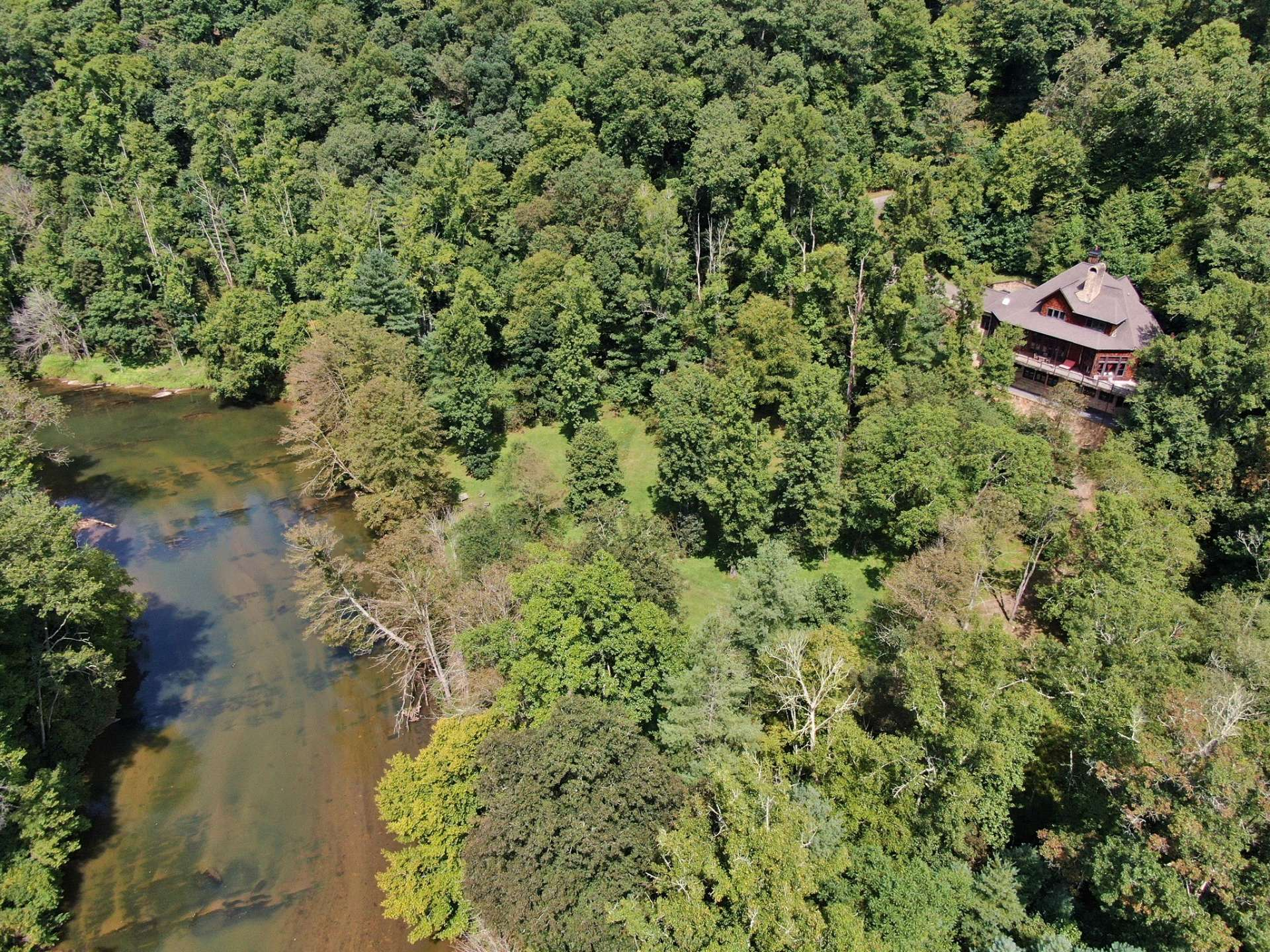 This unique private lodge type property is offered at $1,200,000 and the ideal NC Mountain riverfront estate located in the New River Bluffs community in the Glendale Springs area of Eastern Ashe County.