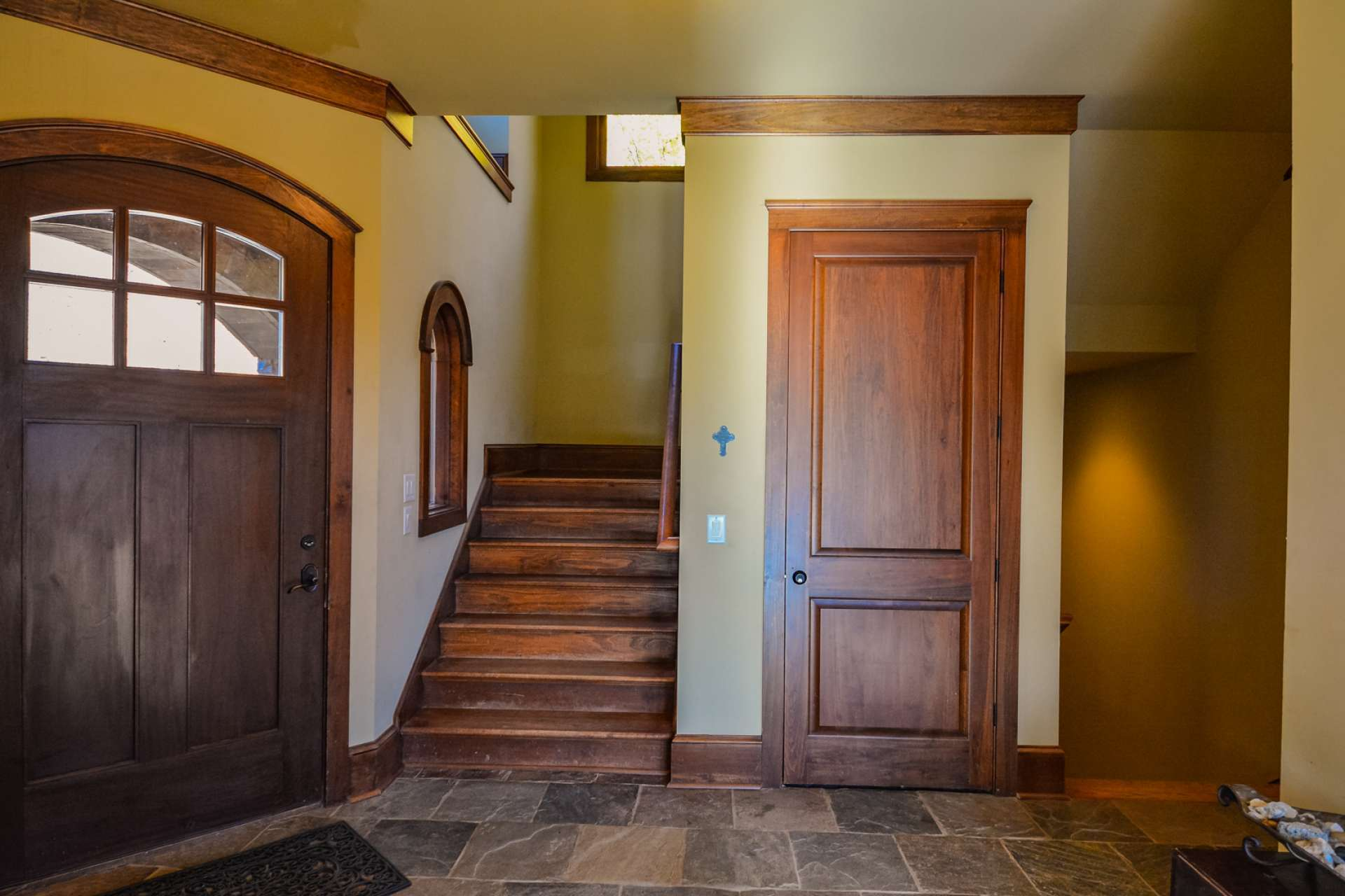An inviting foyer welcomes you and guests with warm accents. There is even an option for an elevator.