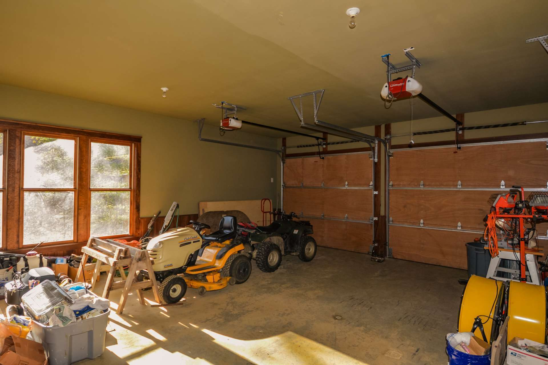 The 2-car garage has spigots with both hot and cold water, as well as a floor drain.