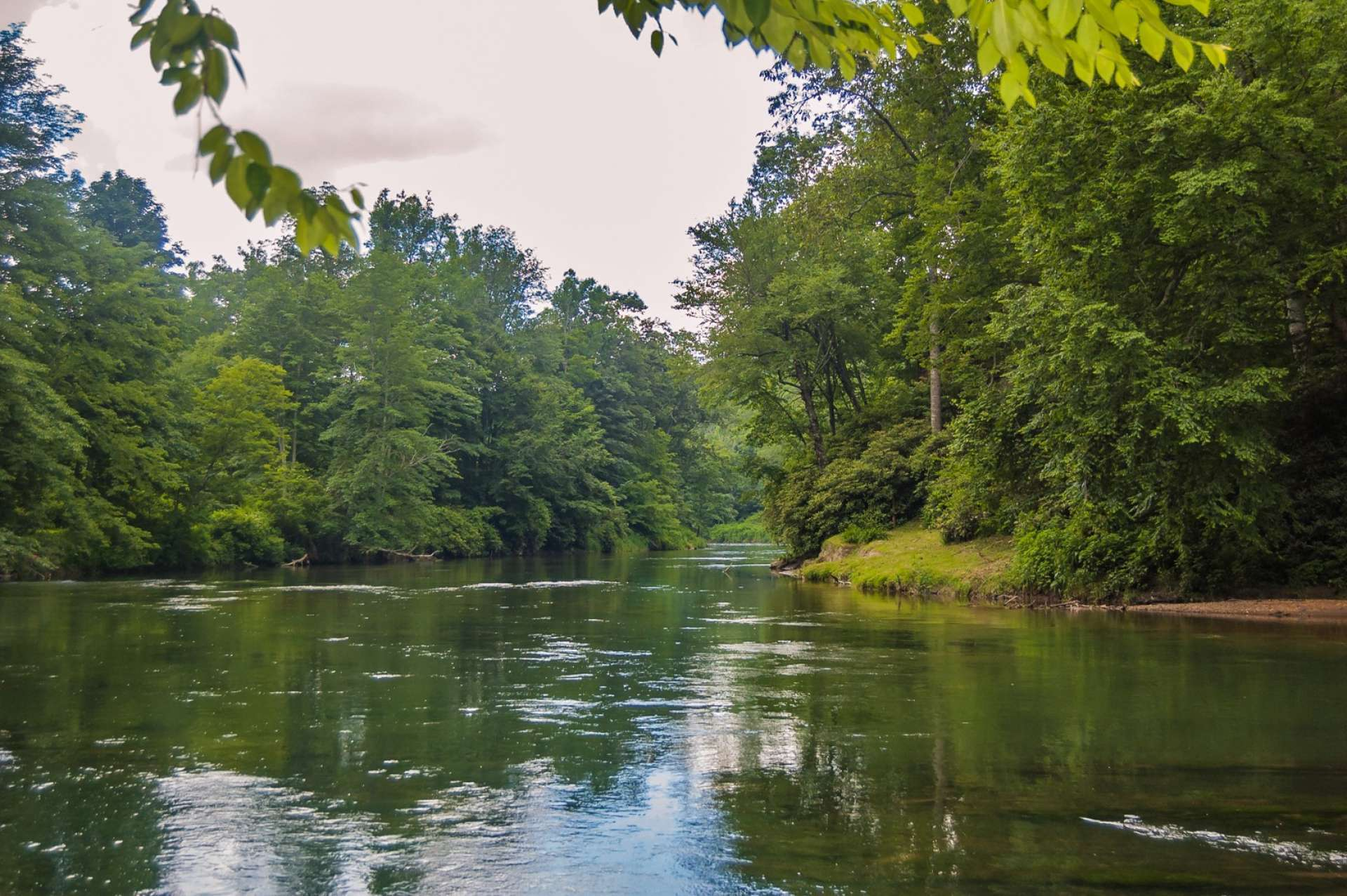 Private level river frontage enables easy access for water sports such as tubing, kayaking, canoeing, and fishing.