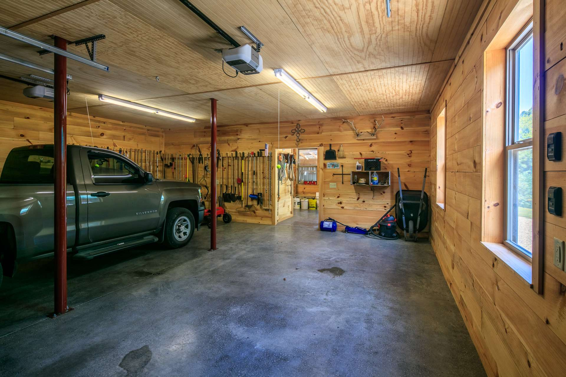 Not only does the garage offer plenty of space for vehicles, it also features a nice workshop area.