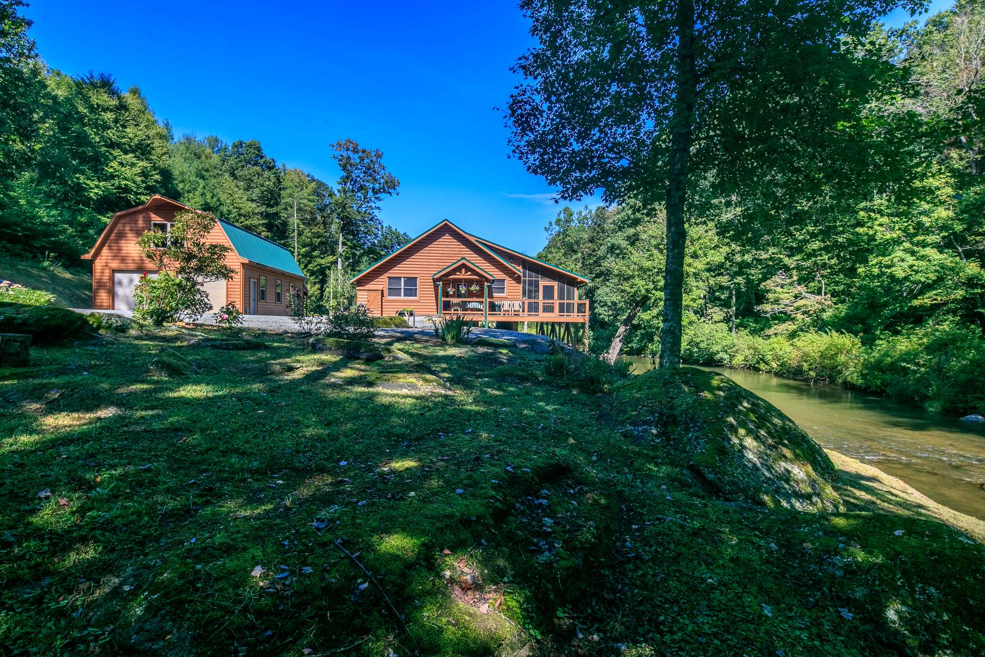 TRULY A RARE FIND!  You will feel like you have your own private park with this 2-bedroom, 2-bath cabin nestled among  30+ unrestricted acres with bold trout stream.