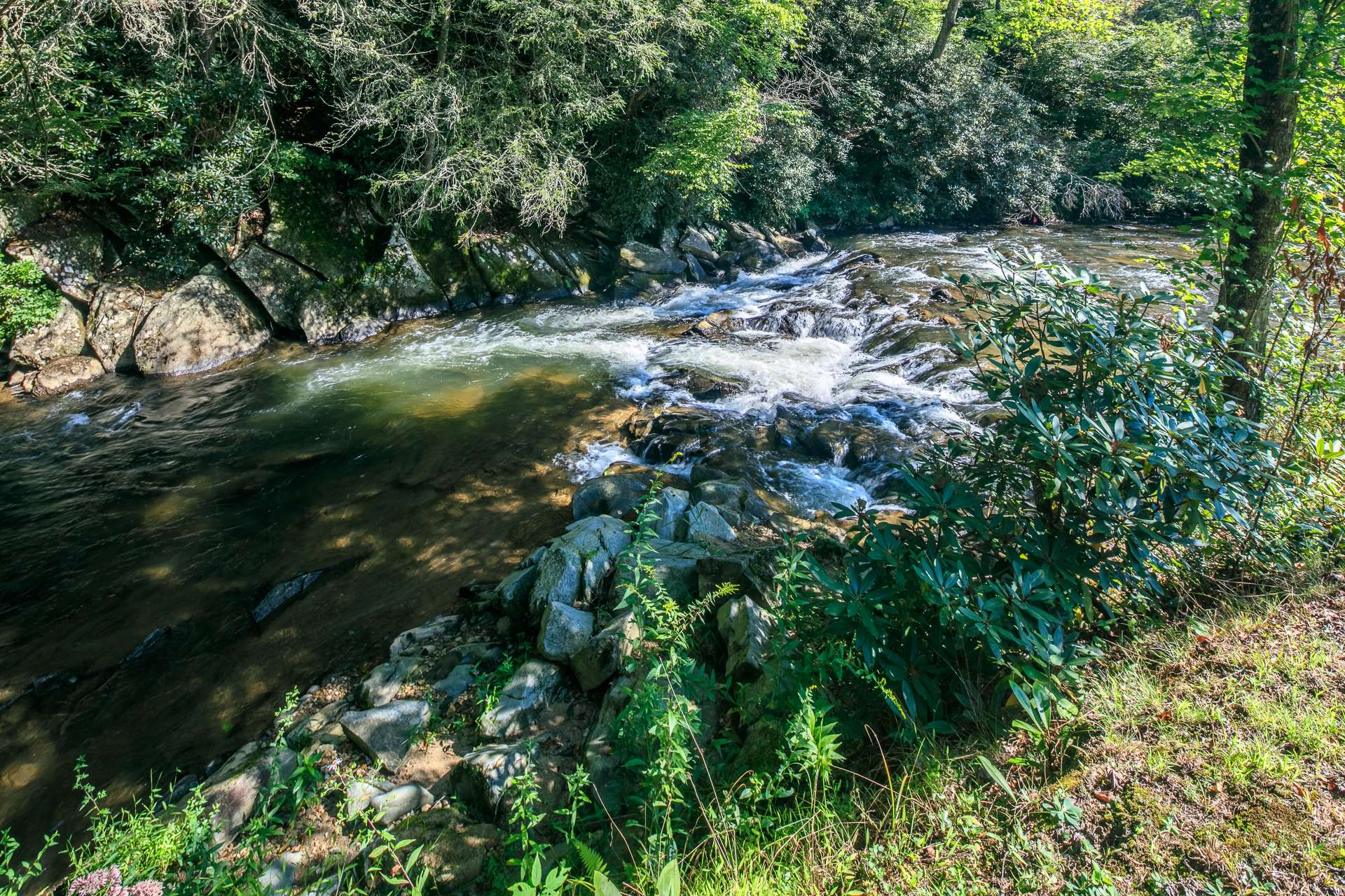 Cranberry Creek is a hatchery supported trout stream with nice rapids and beautiful huge boulders.  Not only do you have approximately 2000 feet of creek frontage, but you will own land on both sides of the creek.